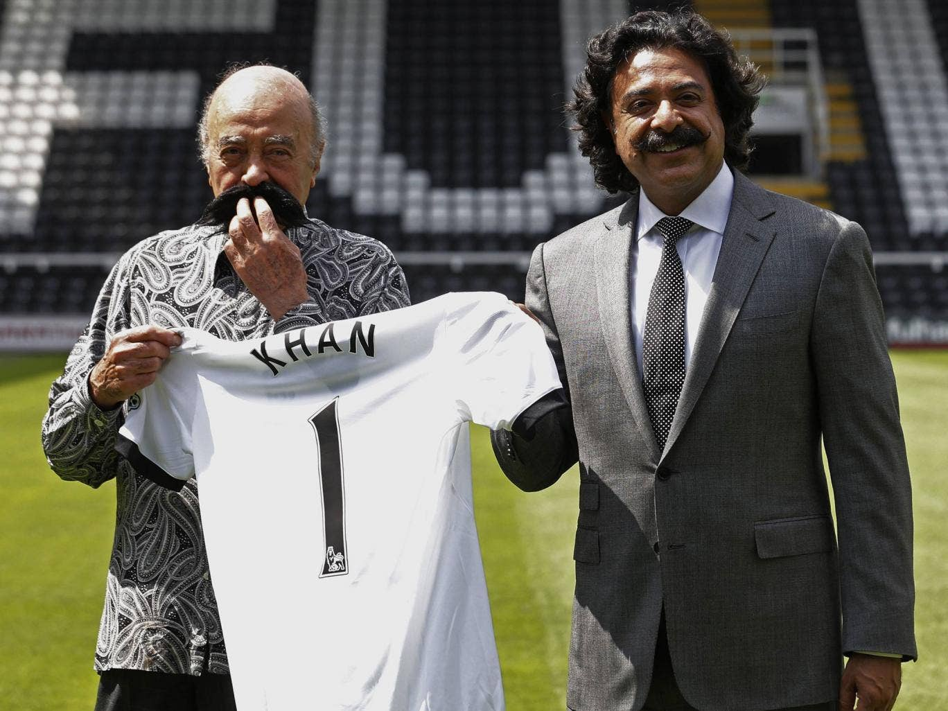 Lip service: Mohamed Al Fayed (left) welcomes new Fulham owner Shahid Khan to Craven Cottage