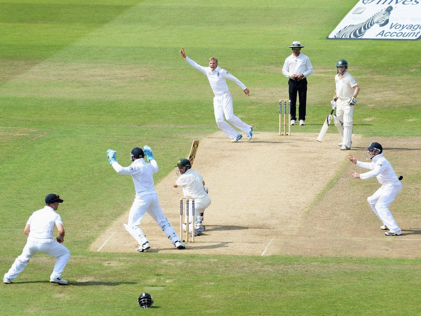 Root to success: Ed Cowan edges a delivery from Joe Root to Jonathan Trott at slip to the delight of the fielders
