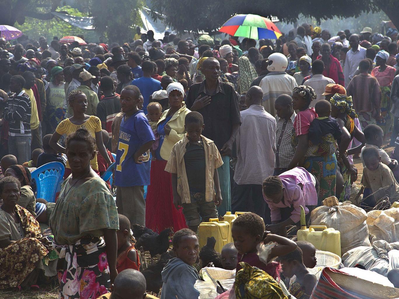 Congolese refugees wait at the Busunga border post in Uganda