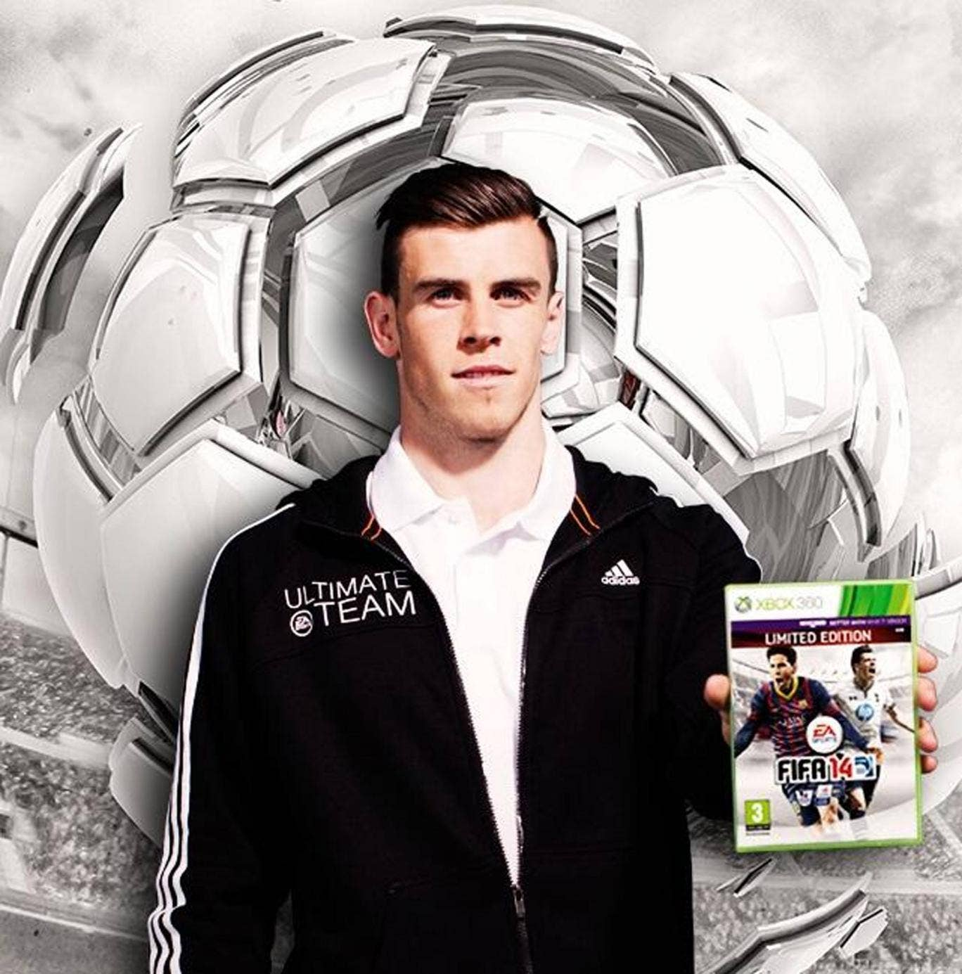 Gareth Bale with the a copy of Fifa 14