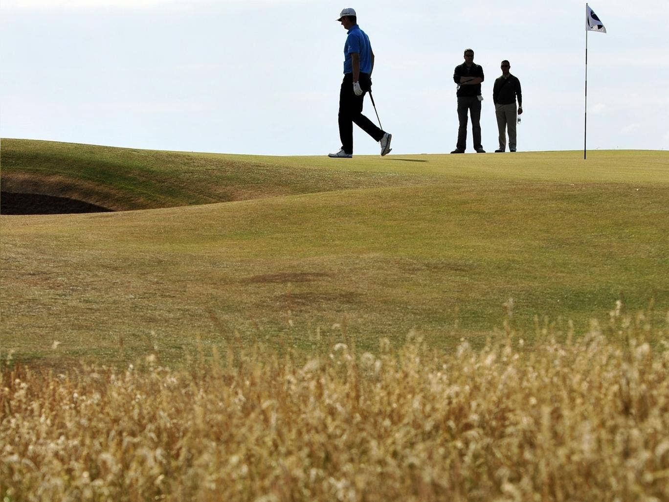 Justin Rose walks on the seventh green during a practice round