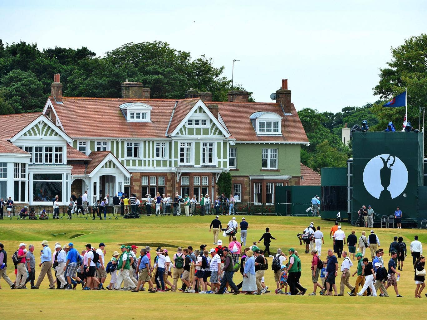 Golf fans make their way across the 18th fairway during practice for the Open Championship at Muirfield