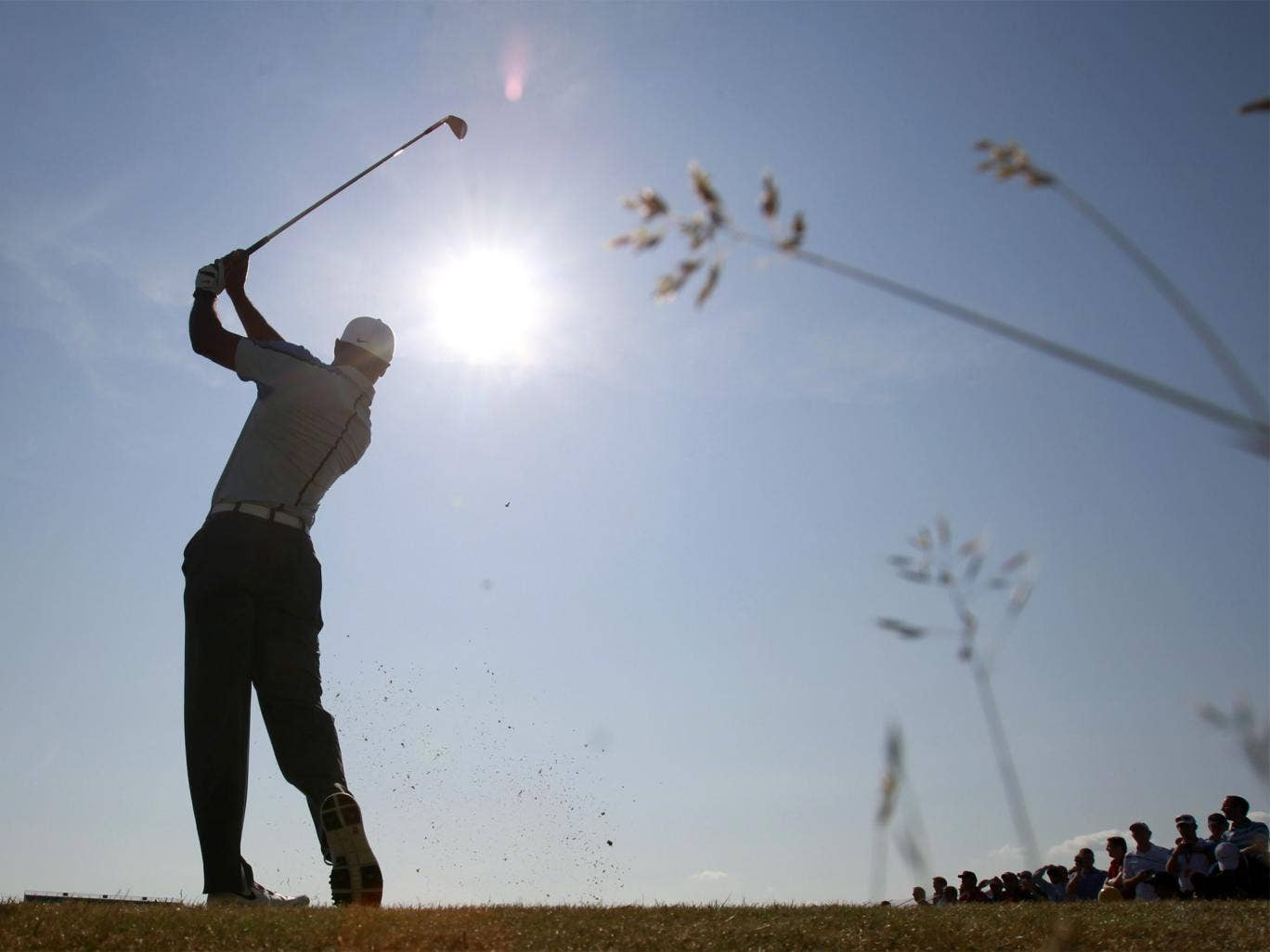 Tiger Woods plays a shot on the 15th hole during his practice round