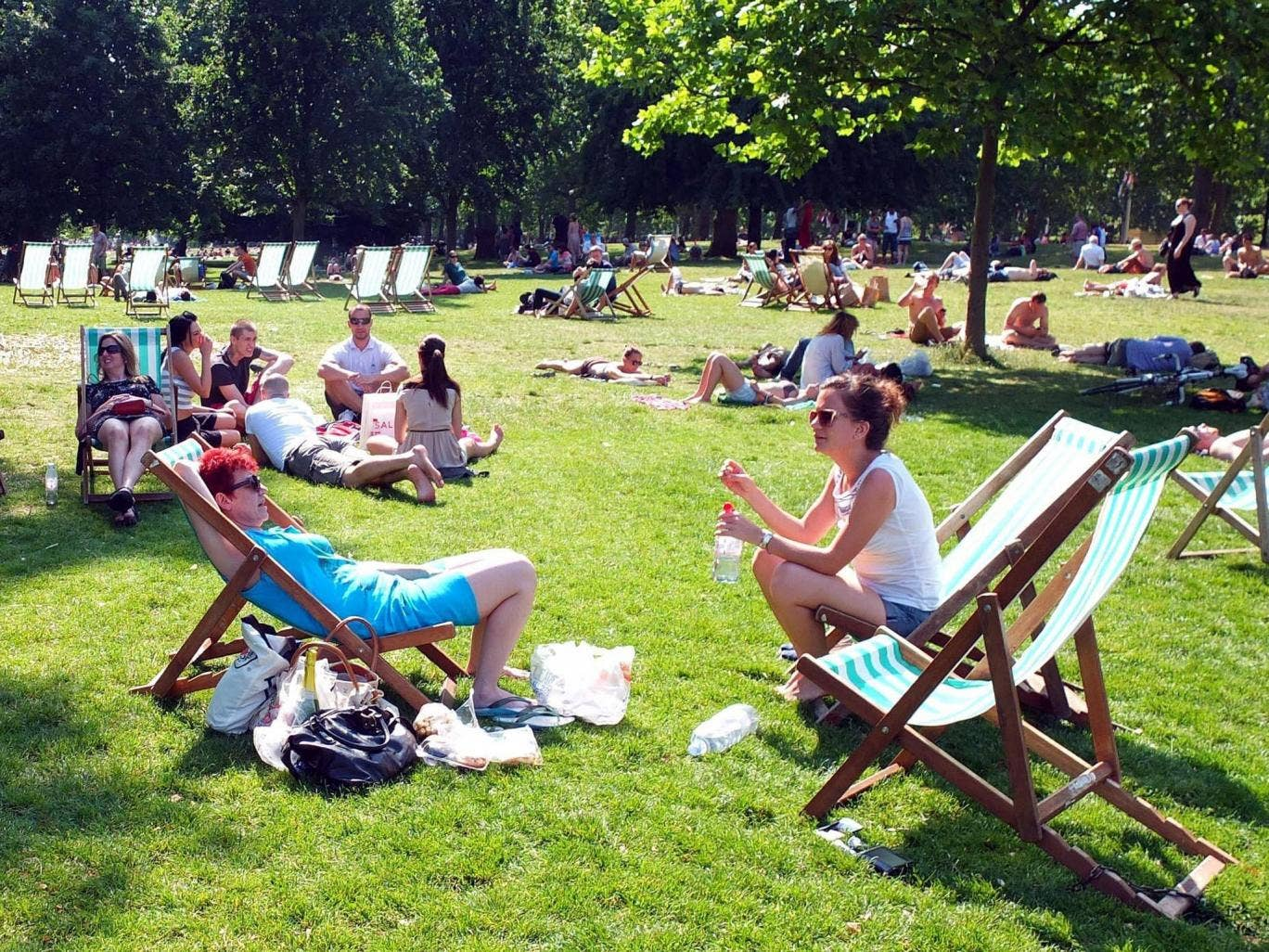 Sunbathers in St James Park, London, as much of Britain is bathed in sunshine