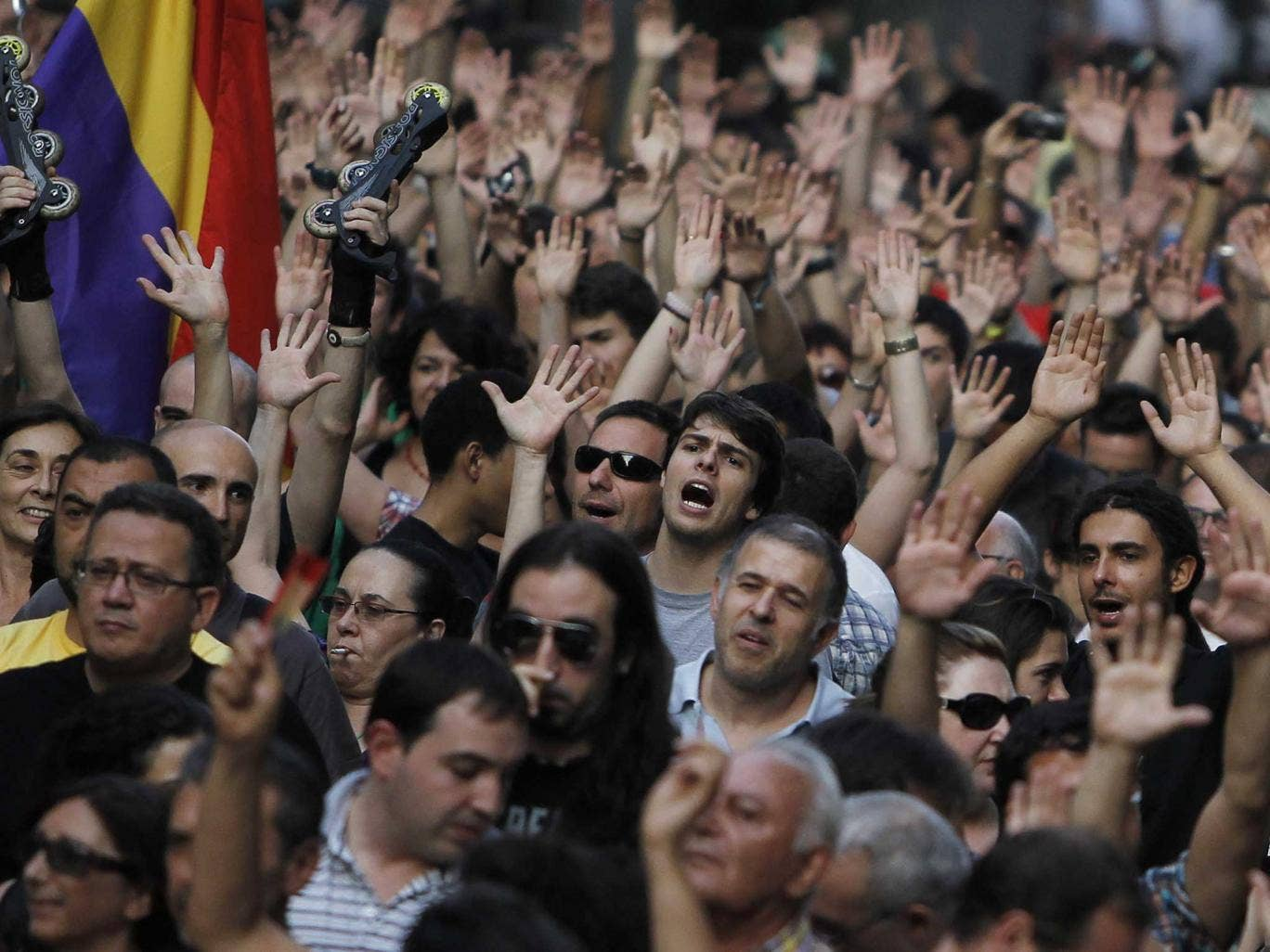 Protesters shout slogans during a demonstration against the Spanish government