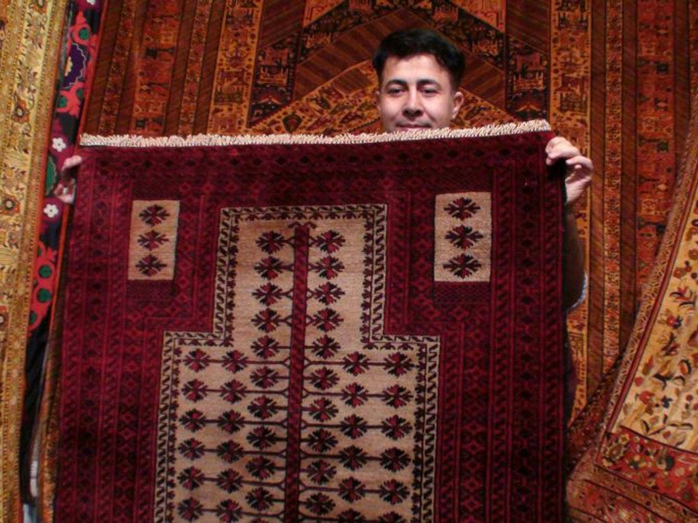 Millions of hand-woven rugs are turned out in Tehran but machine-made alternatives are  beginning to outsell them