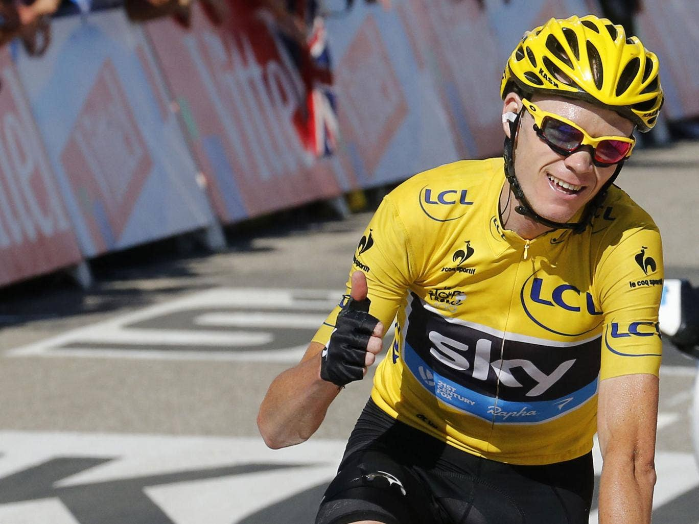 On the road to Paris: Tour leader Chris Froome finishing yesterday's stage