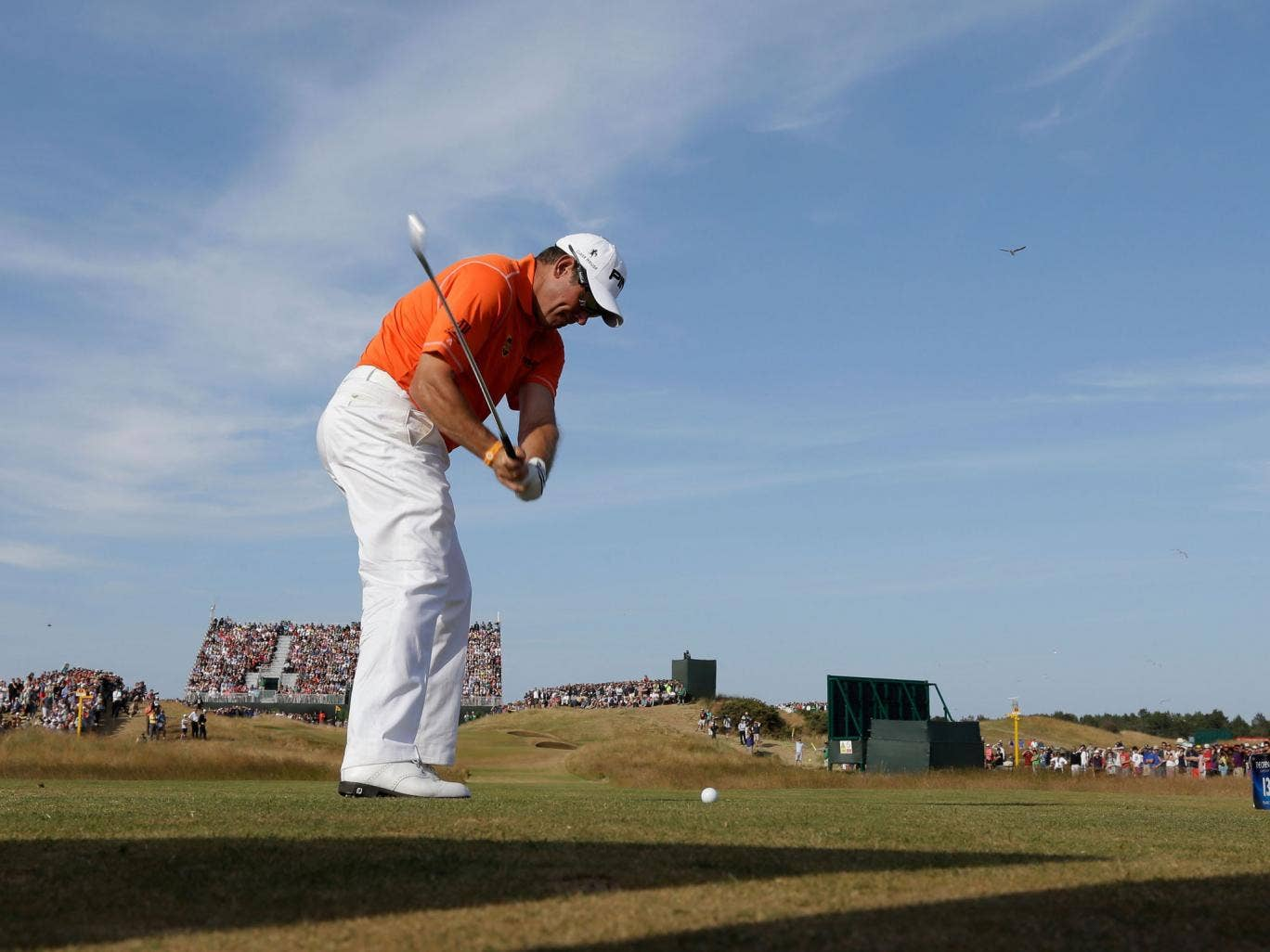 Out of the blue: Lee Westwood on the 13th tee at Muirfield on his way to a two-stroke lead