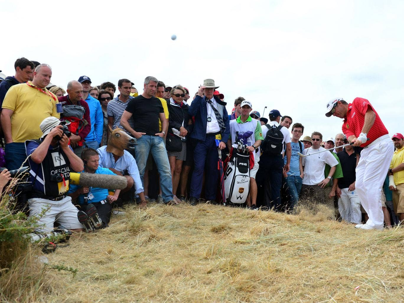 Lee Westwood plays out of the rough on his way to a four-over-par final round as he slipped from first to a tie for third