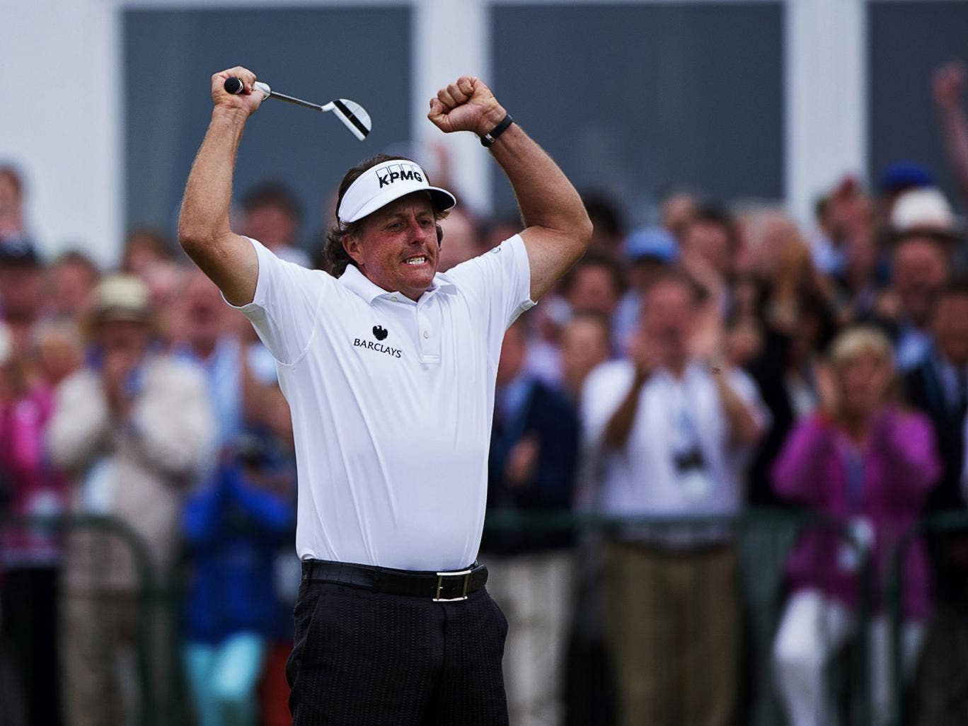 Phil Mickelson celebrates his birdie on the 18th
