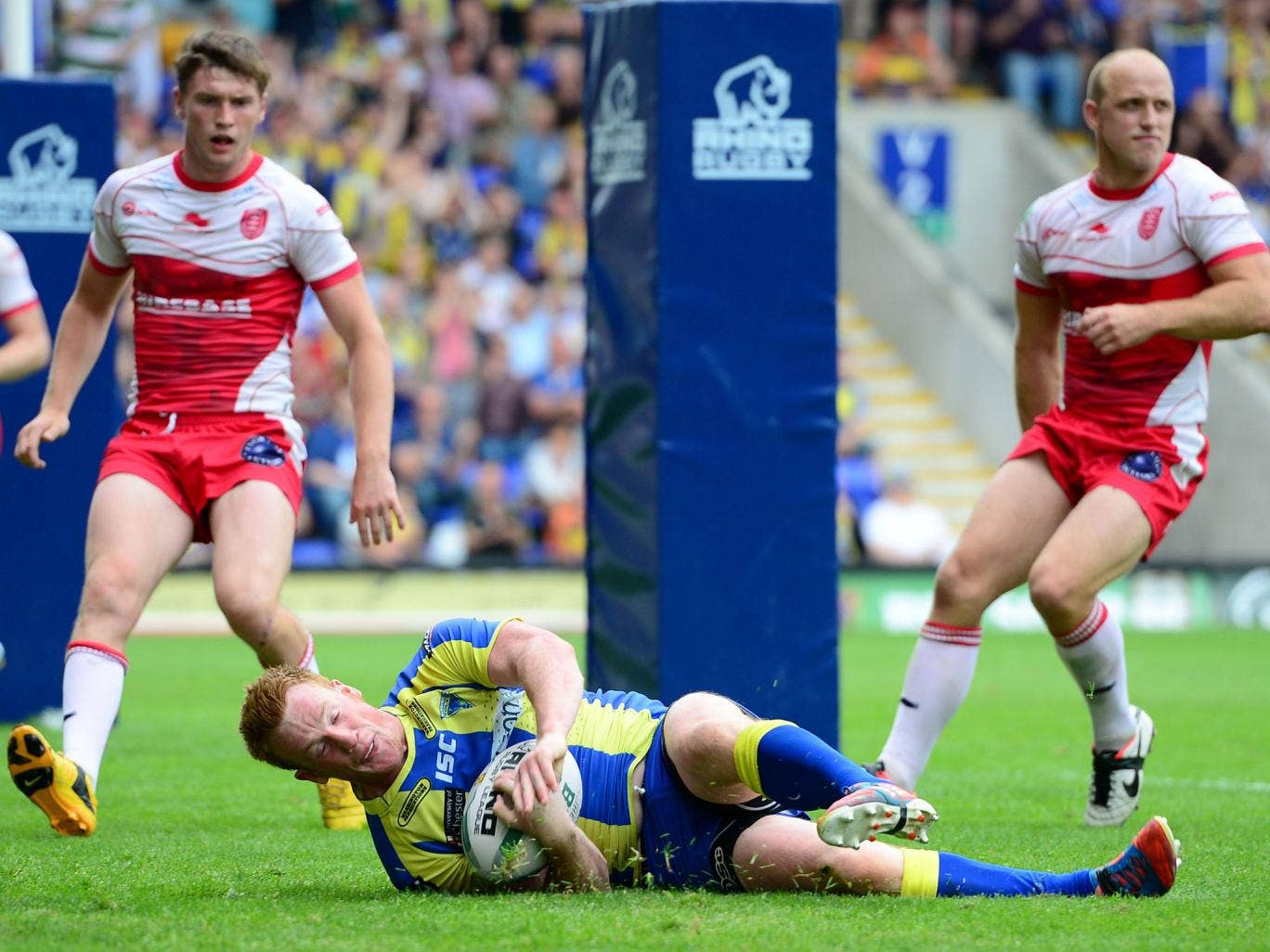 Warrington's Chris Riley goes over for a try