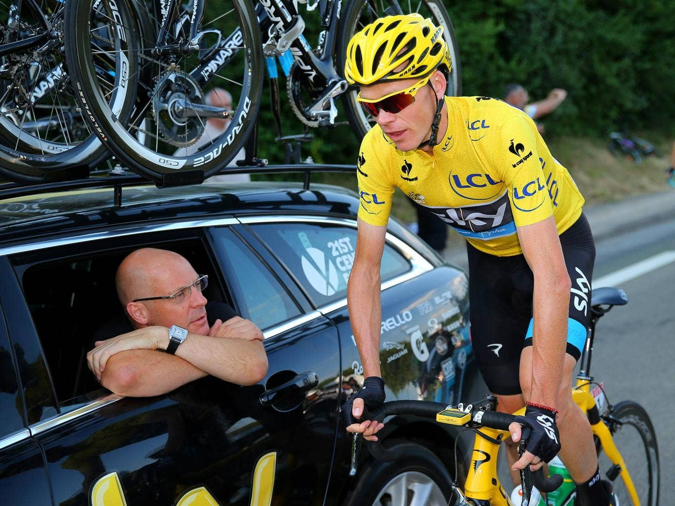 Sir Dave Brailsford speaks with the winner of the 2013 Tour de France, Chris Froome, during the final stage