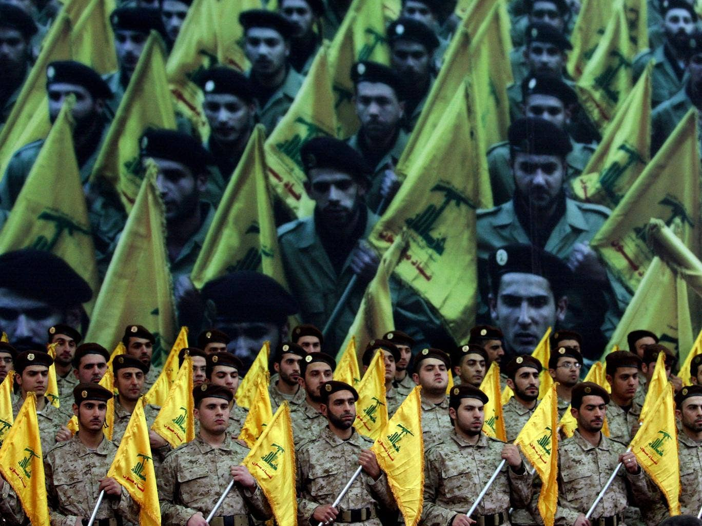 Shiite Muslims Hezbollah militants stand to attention