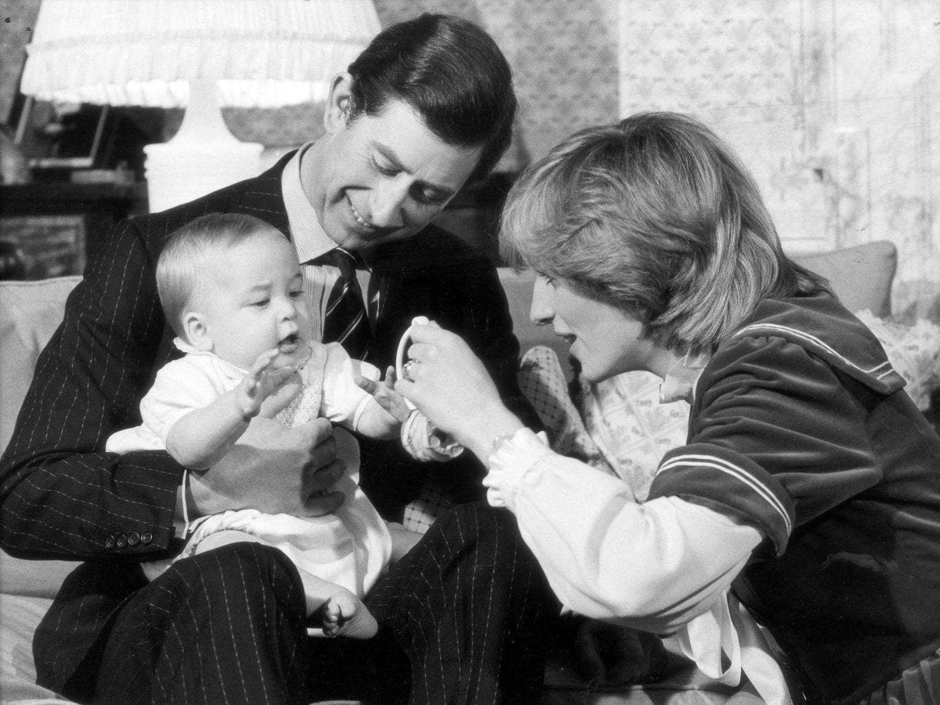 William, in 1982, photographed with his mother and father at Kensington Palace