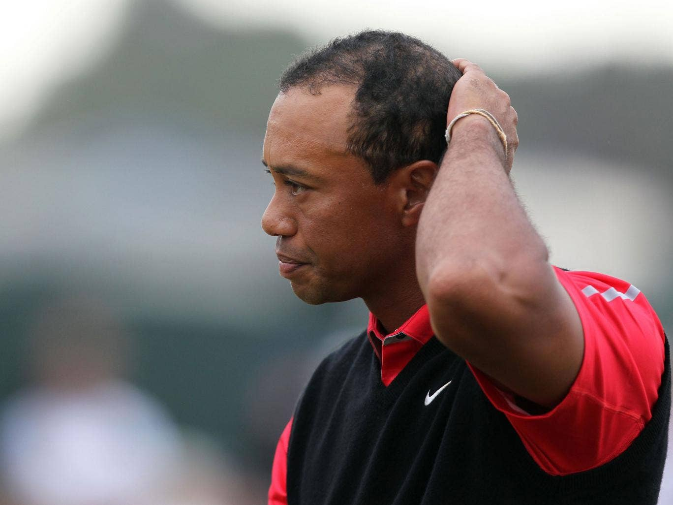 Tiger Woods reacts after finishing his final round