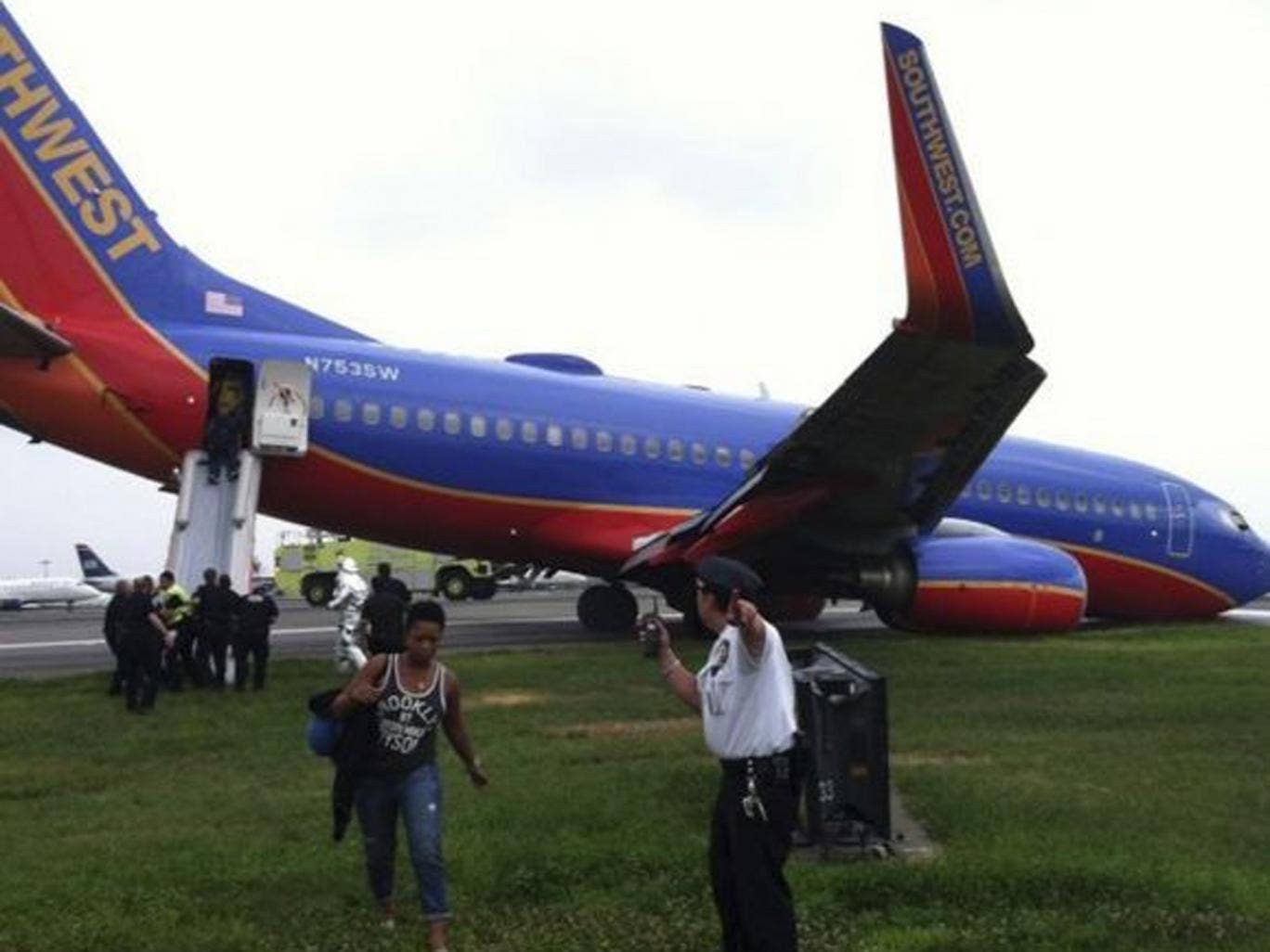 The Southwest Airlines plane sits on the tarmac as passengers disembark at LaGuardia airport, New York