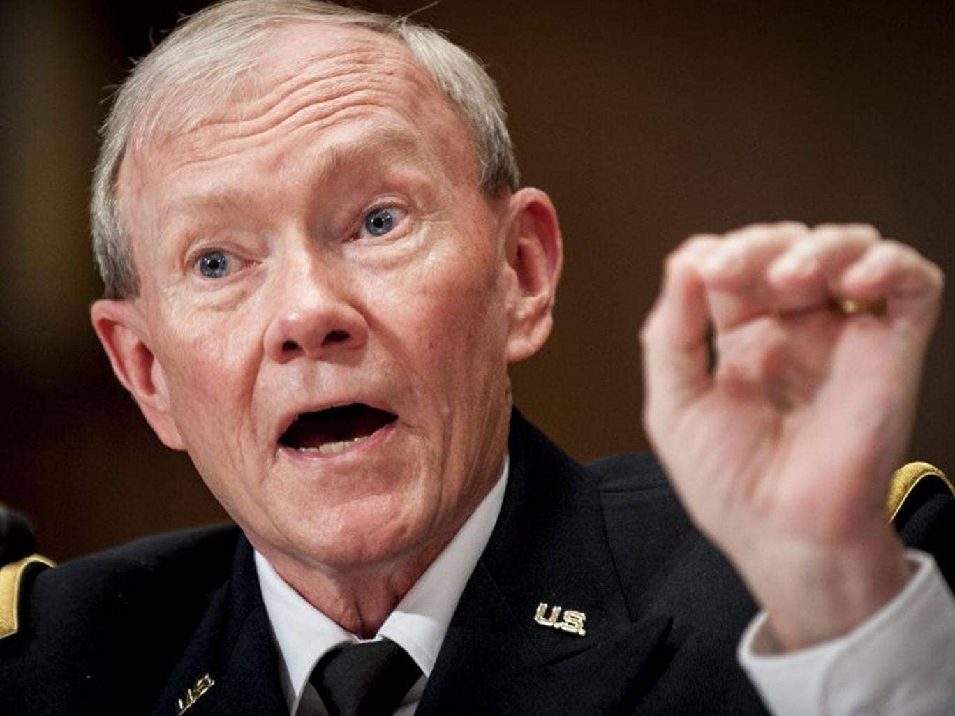 """General Martin Dempsey warned that any action to limit bloodshed in the Middle Eastern country would be """"no less than an act of war"""""""