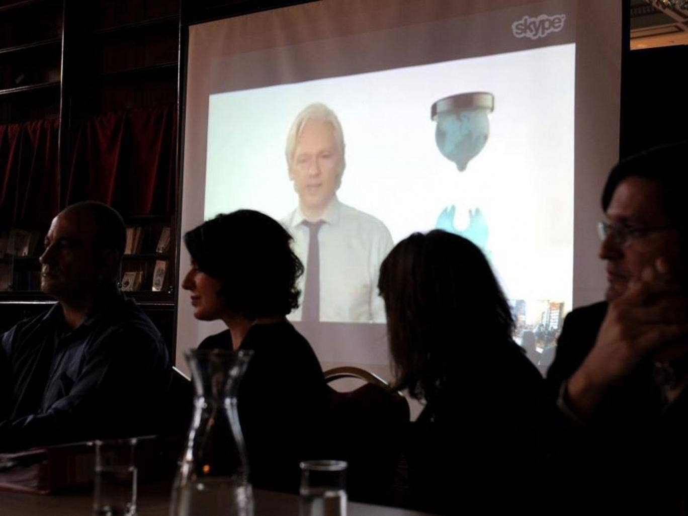 Wikileaks Party candidate Julian Assange speaks from London during the official launch and announcement of Senate candidates in Melbourne, Australia
