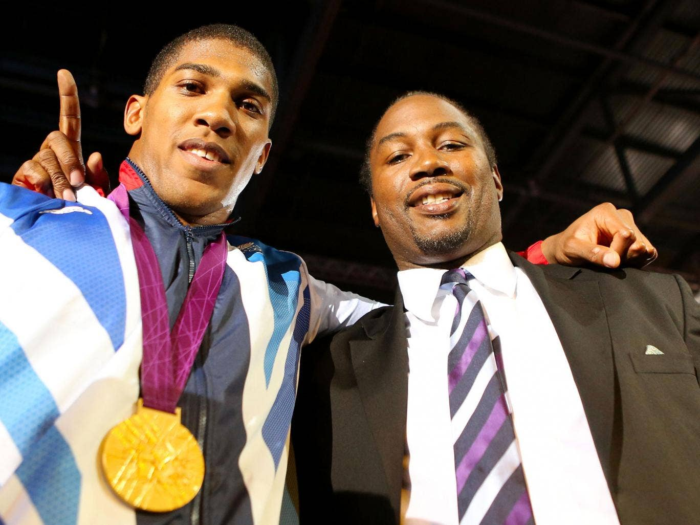 Anthony Joshua (left) with Lennox Lewis at the Olympics