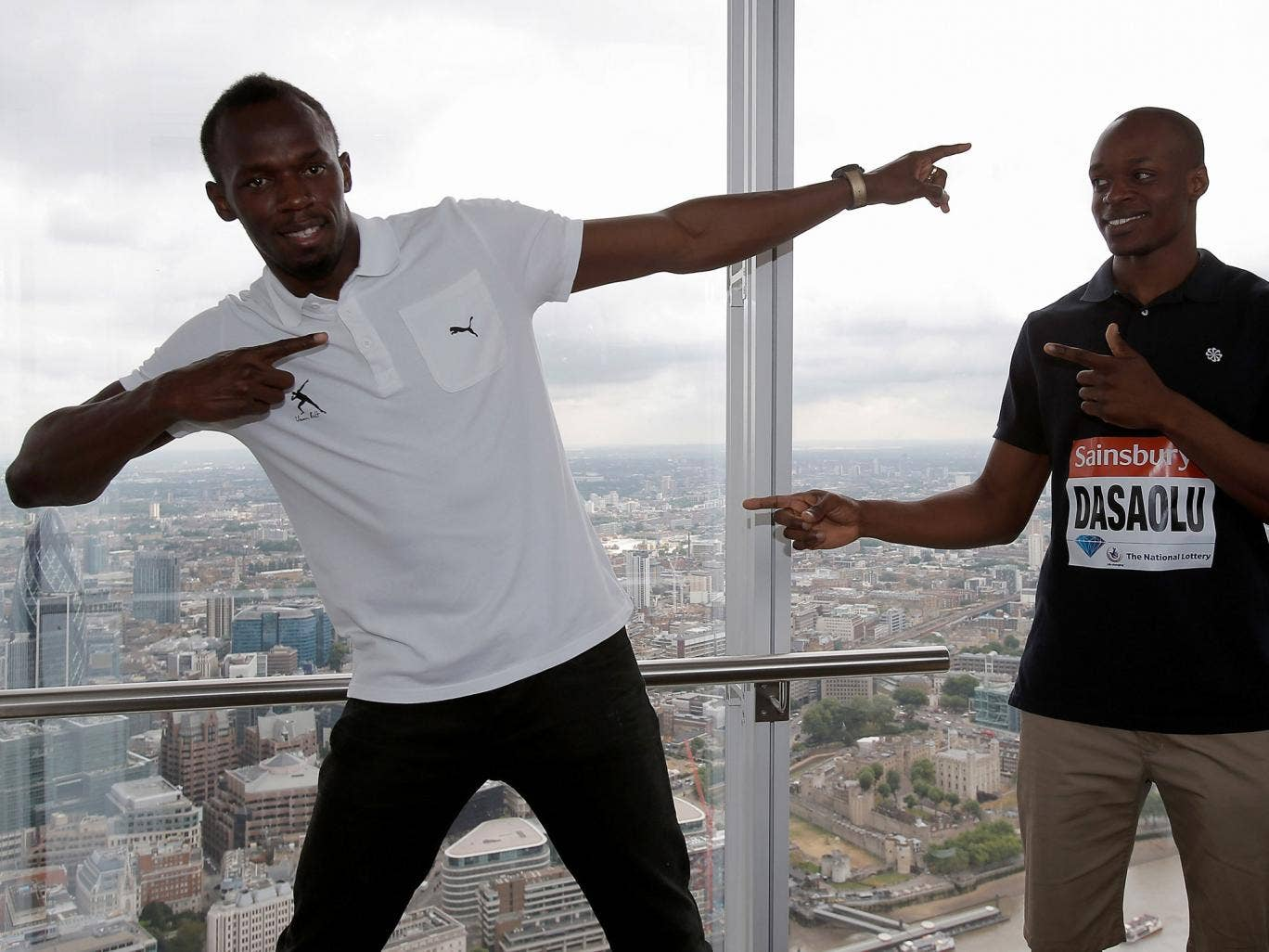 Usain Bolt (left) and James Dasaolu visit the Shard in London