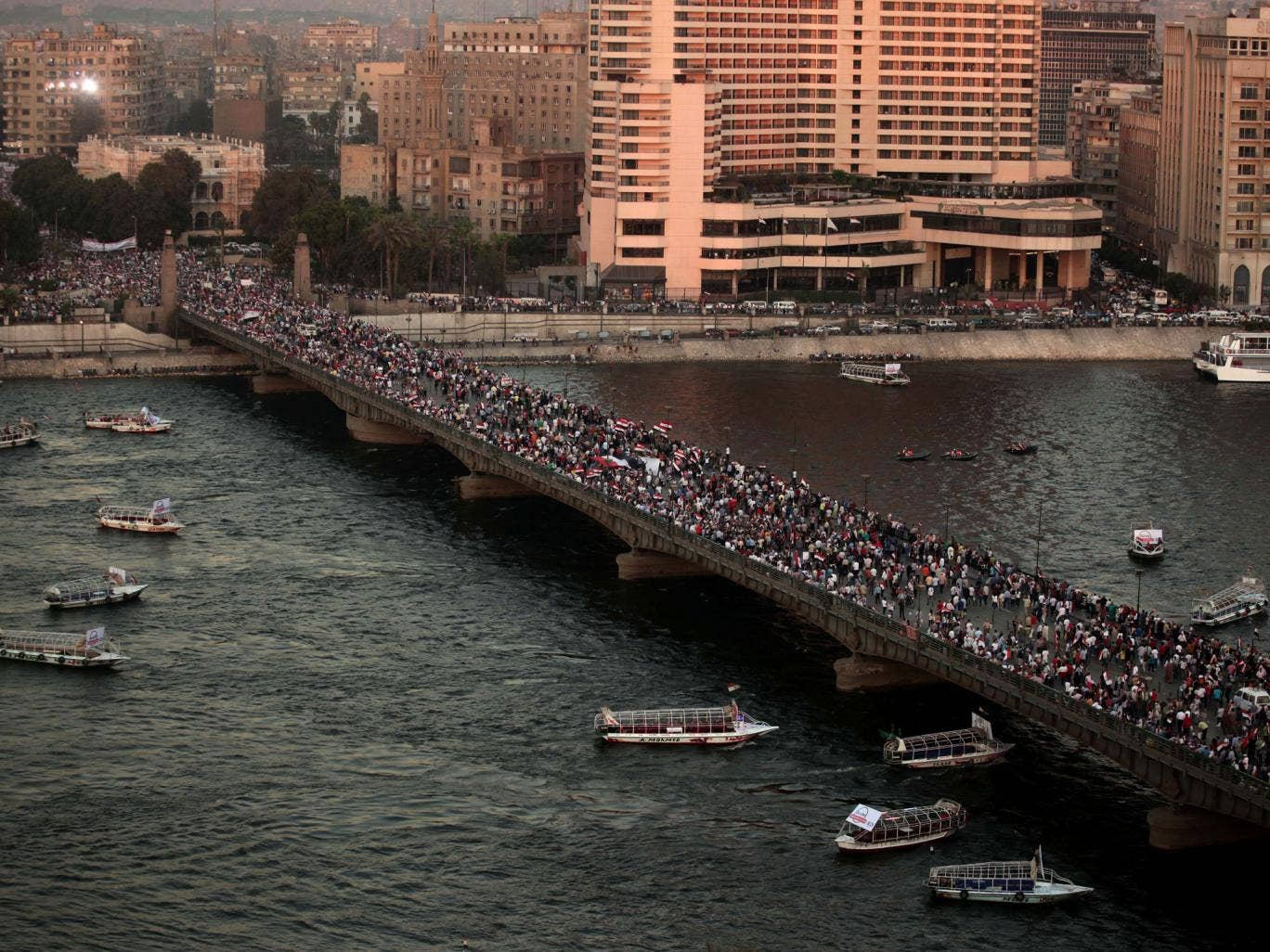 Supporters of Egypt's top military officer, Gen. Abdel-Fatah el-Sissi rally over a bridge leading to Tahrir Square in Cairo