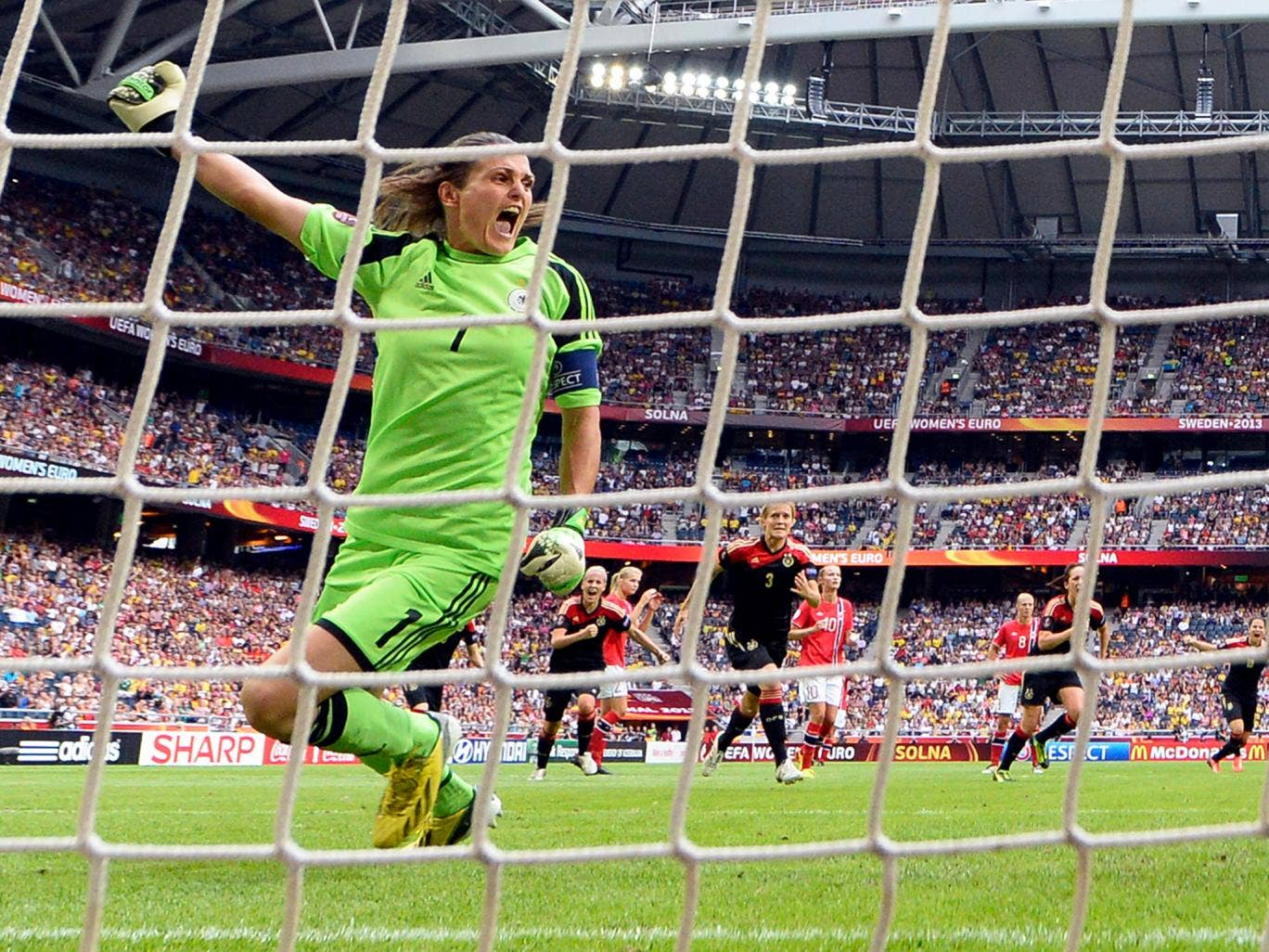 Germany's goalkeeper Nadine Angerer reacts after she saved a penalty shot during the UEFA Women's European Championship Euro 2013