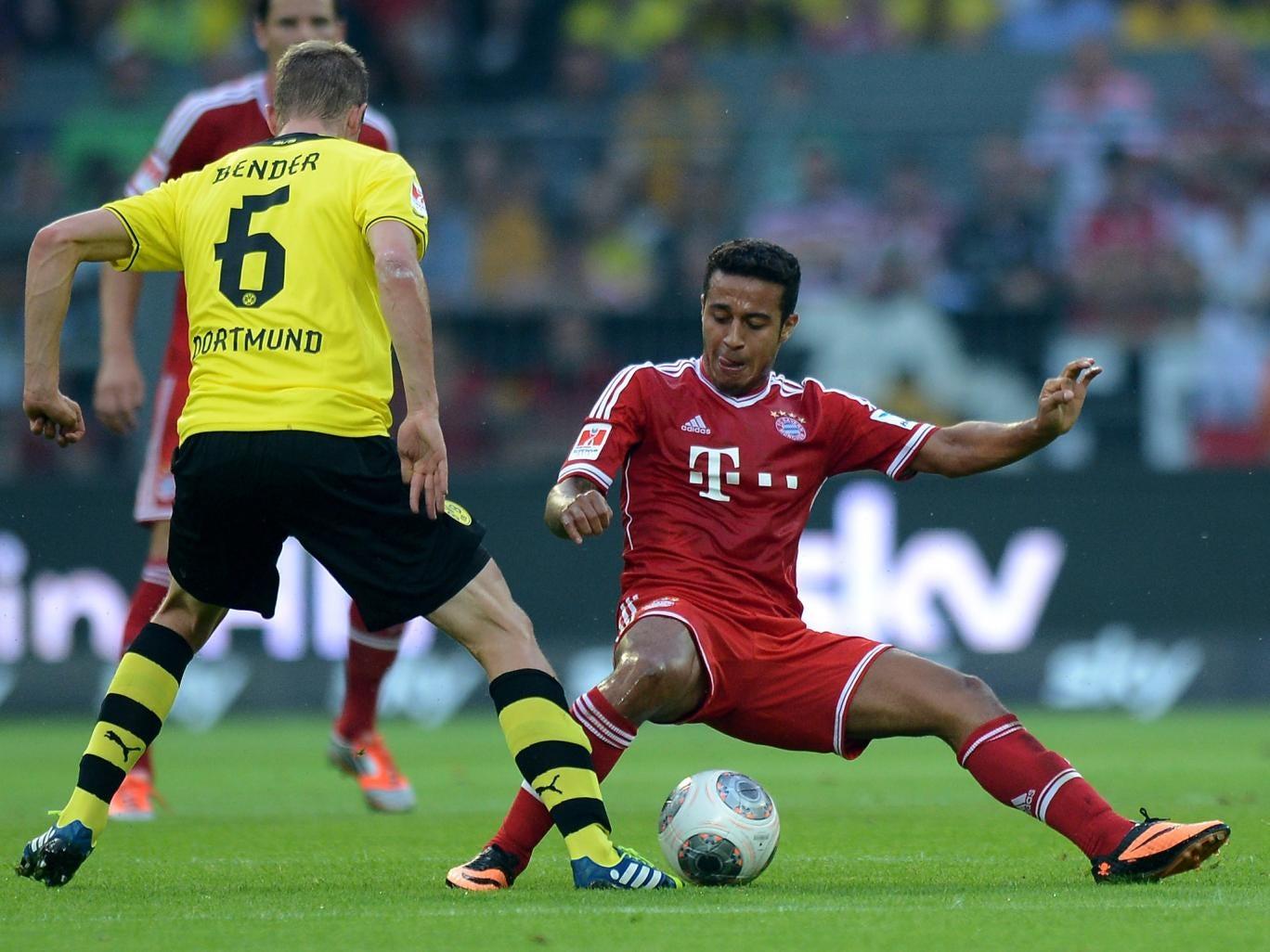 Thiago Alcantara (r) challenges Sven Bender (l) during the 2013 German Super Cup