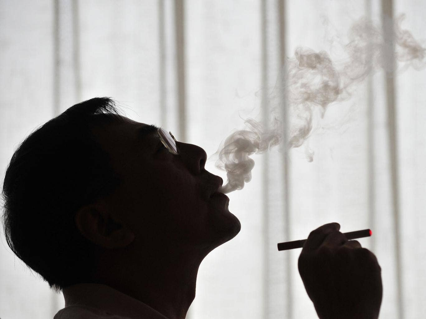 The inventor of the electronic cigarette, Hon Lik smoking his invention in Beiijng in 2009