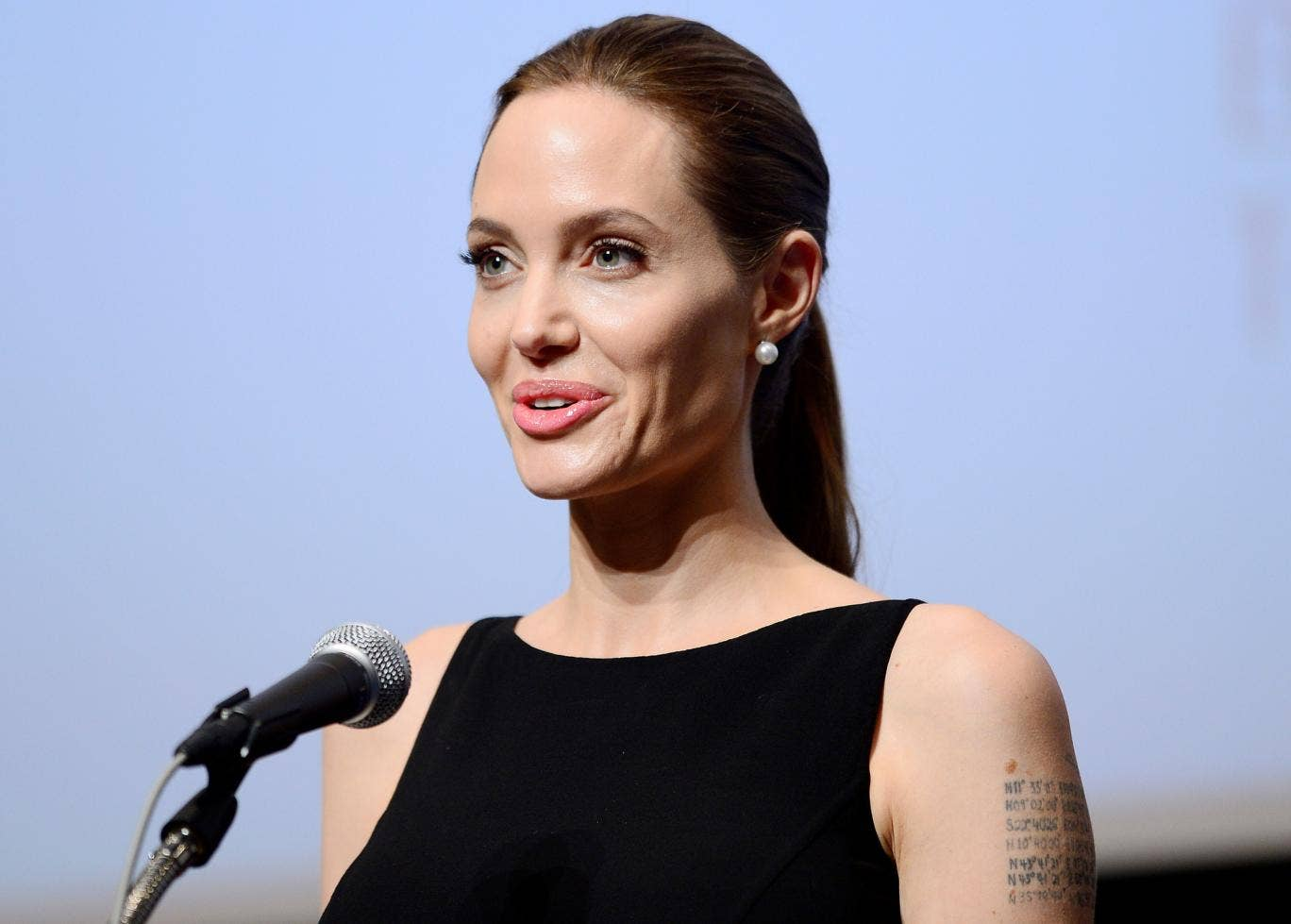 Angelina Jolie makes a speech before a screening of the movie 'In the Land of Blood and Honey' which she directed, at United Nations University in Tokyo on 29 July. She has been named the highest-paid actress in Hollywood by Forbes.