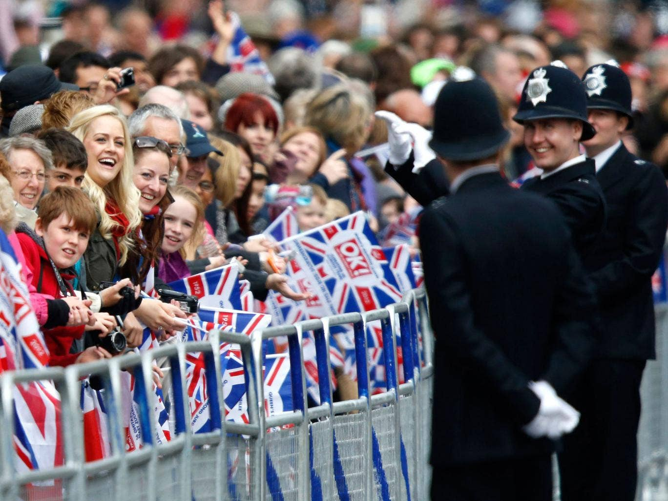 The Government says people in the UK are slightly happier in 2013 because of the Olympics and Diamond Jubilee celebrations