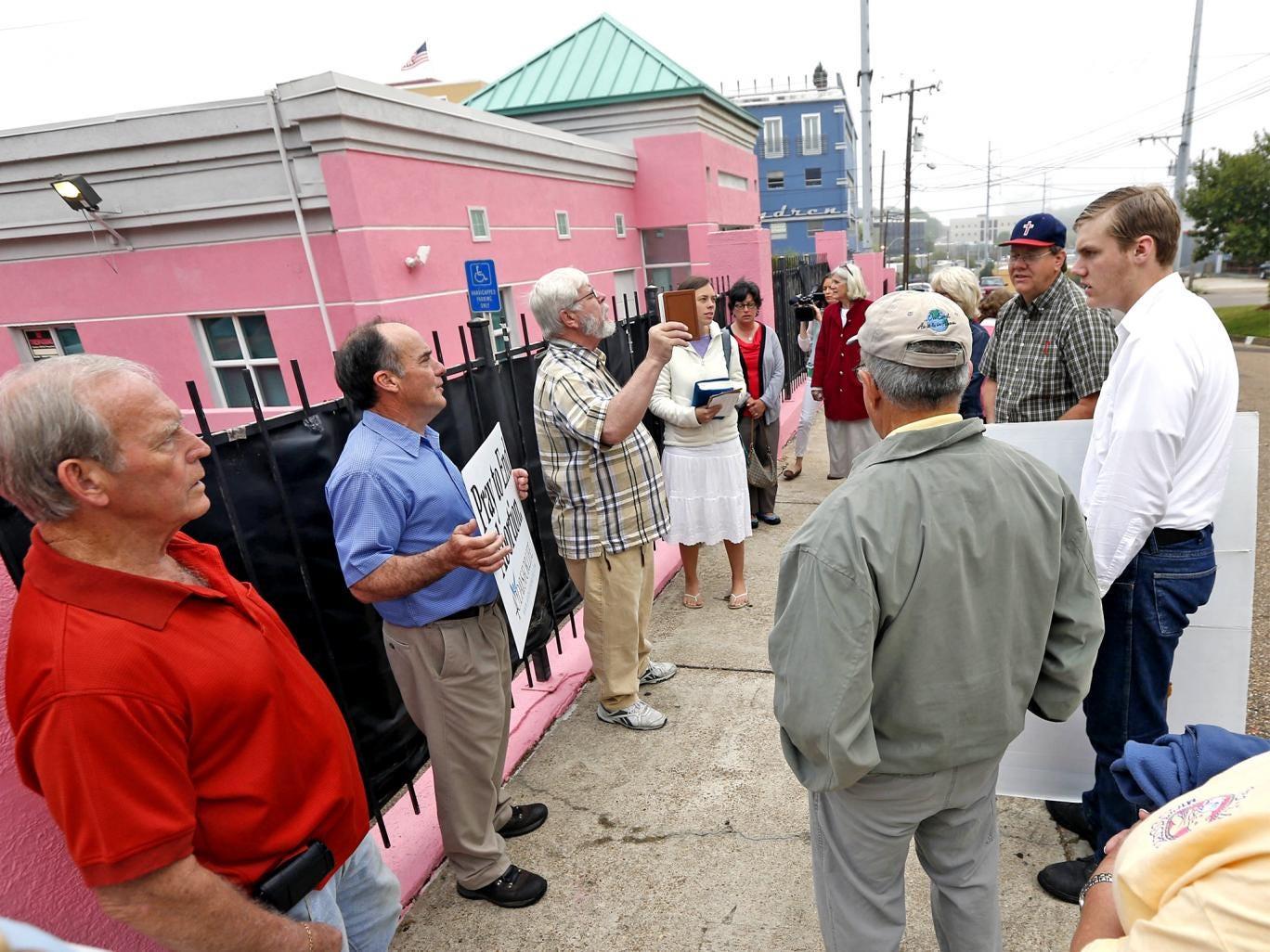 Evangelical Christian opponents of abortion engage in prayer outside Jackson Women's Health Organisation