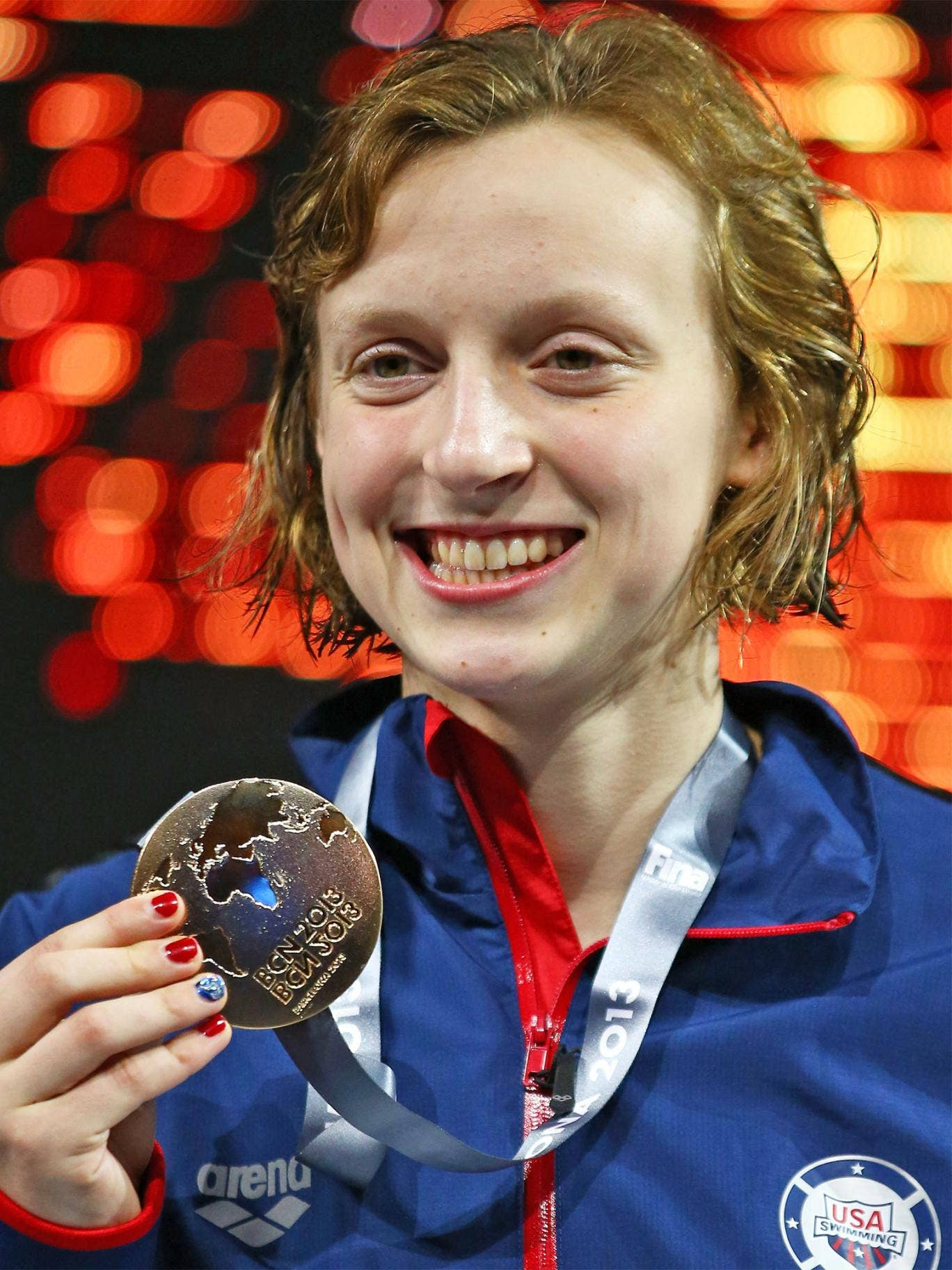 16-year-old Katie Ledecky with her second gold medal of the Championships