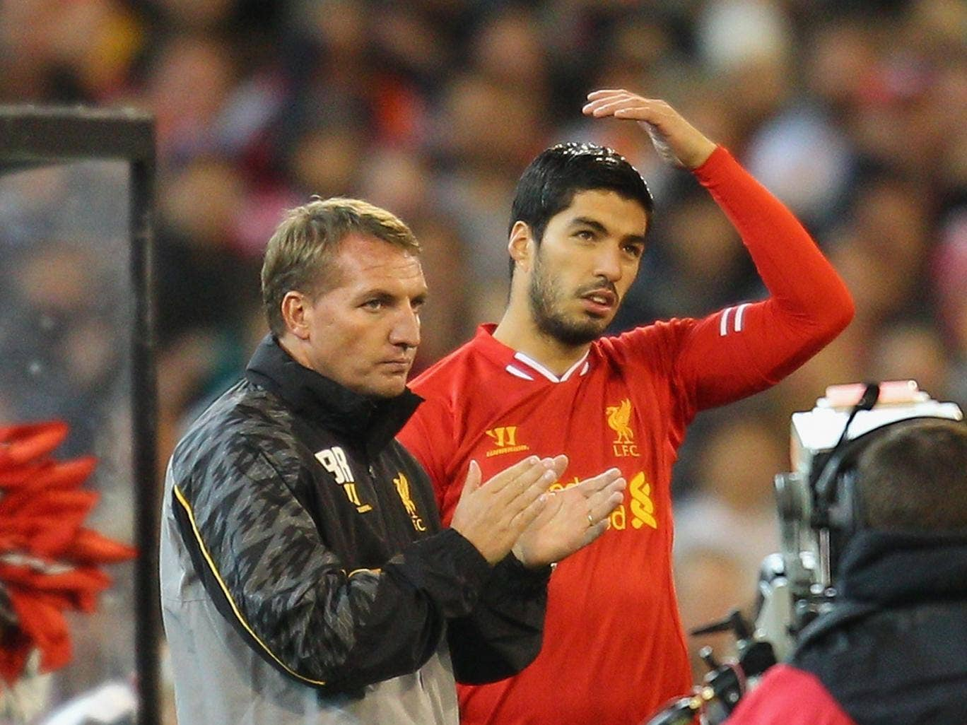 Brendan Rodgers insists Luis Suarez understands why Liverpool are refusing to sell him to Arsenal