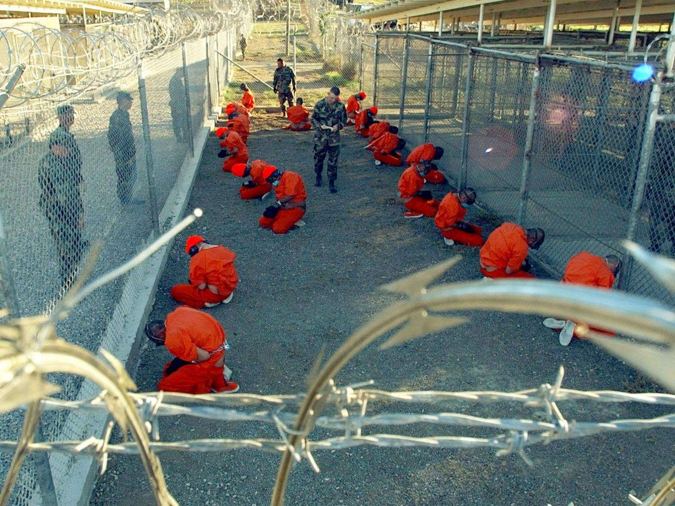 Prisoners in a holding area at Guantanamo Bay, Cuba