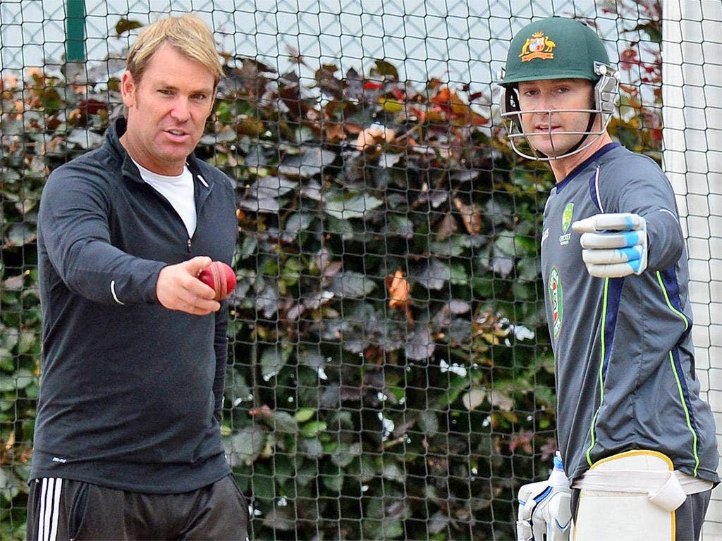 Australia captain Michael Clarke (right) and Shane Warne discuss tactics during Australia's net session