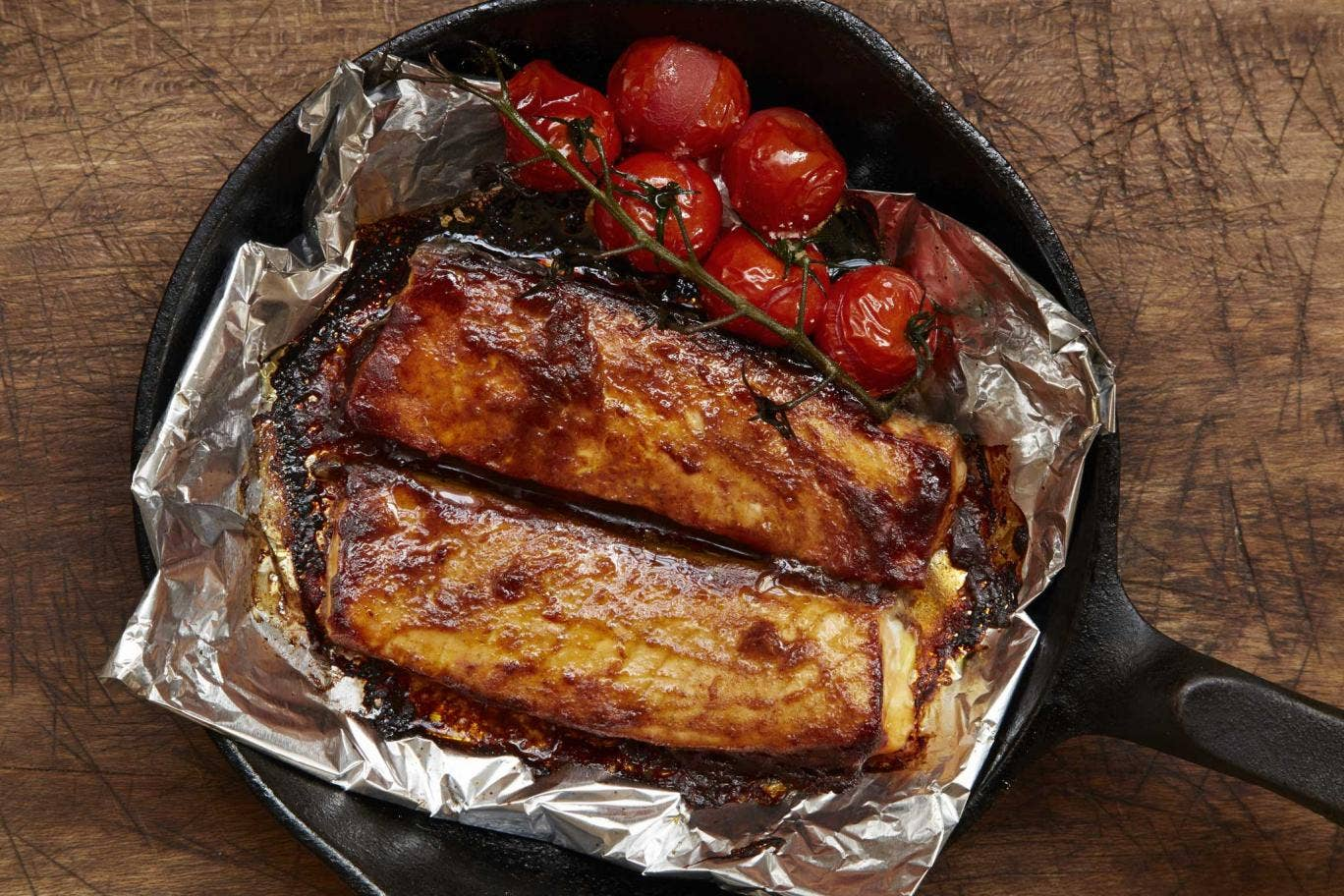 Barbecue-style salmon belly with roast cherry vine tomatoes