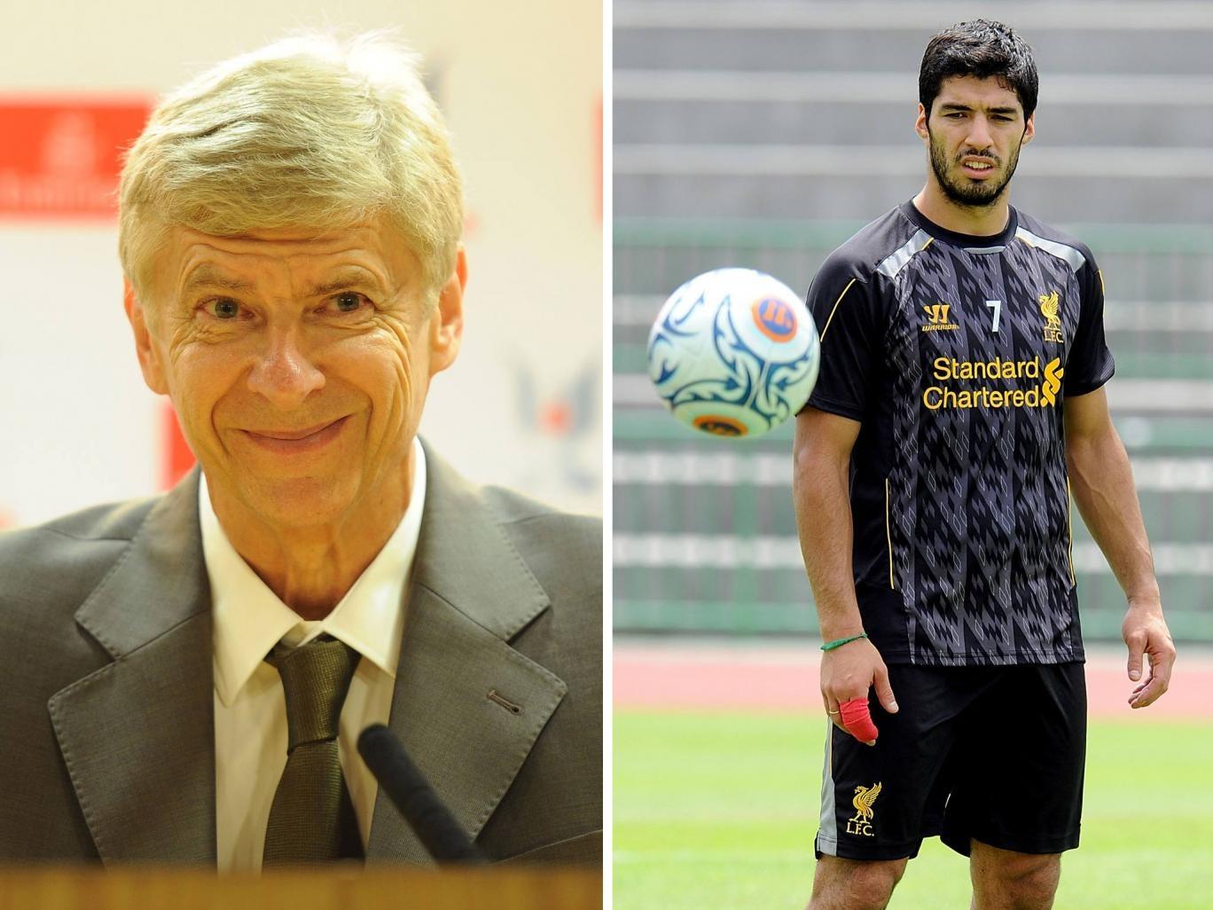 Arsene Wenger and Luis Suarez
