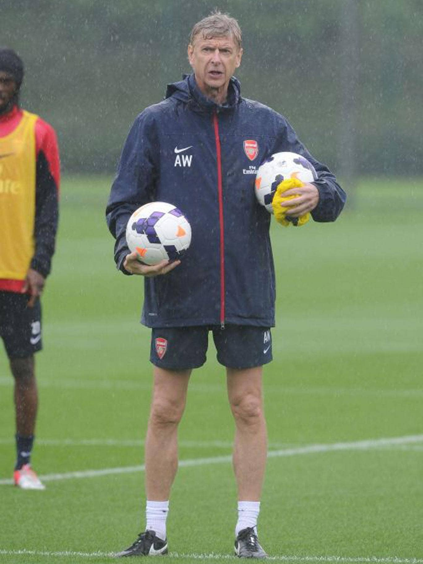 A sodden Arsène Wenger during Arsenal training this week