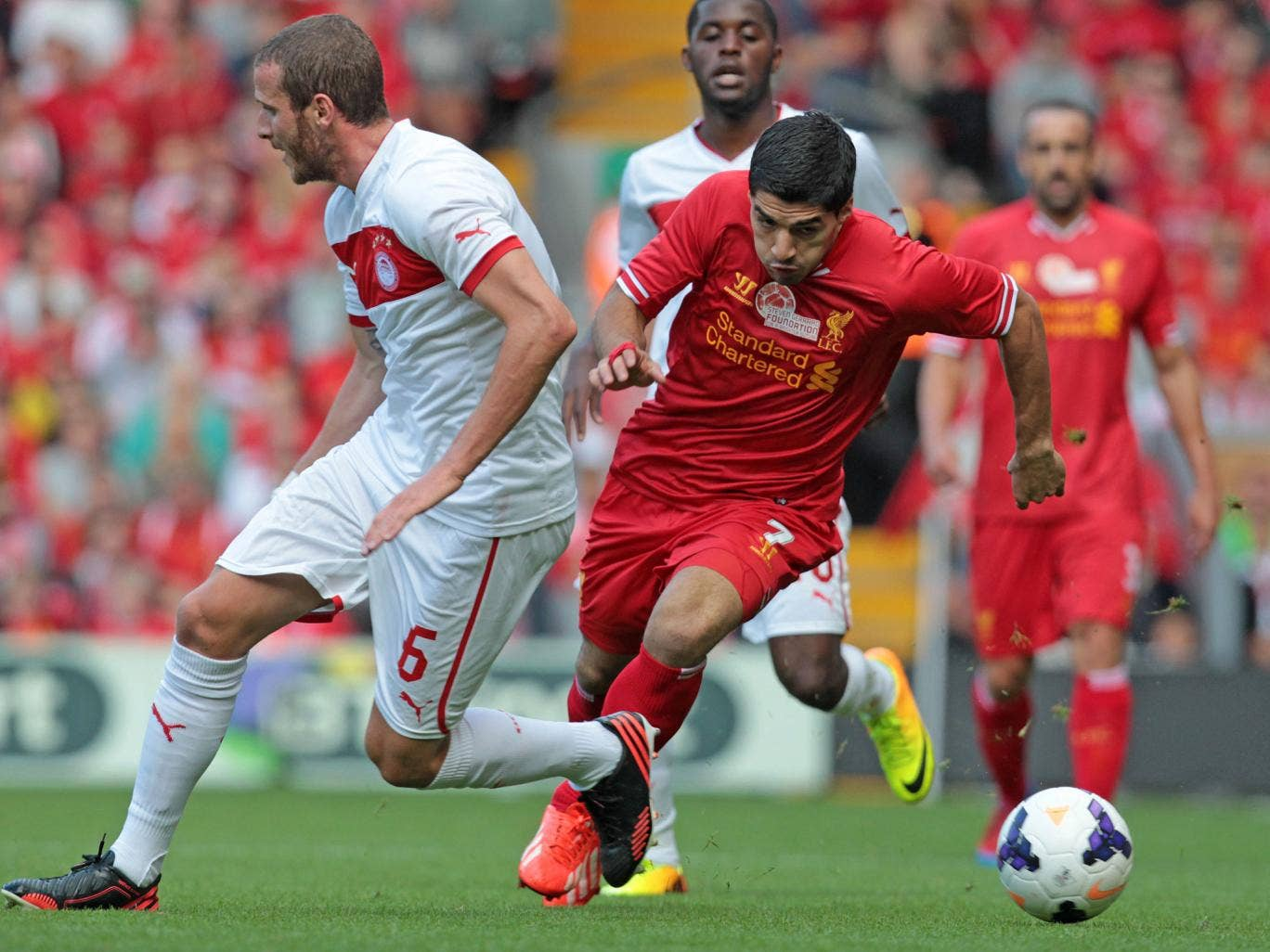 Luis Suarez in action during Steven Gerrard's testimonial as Liverpool take on Olympiacos