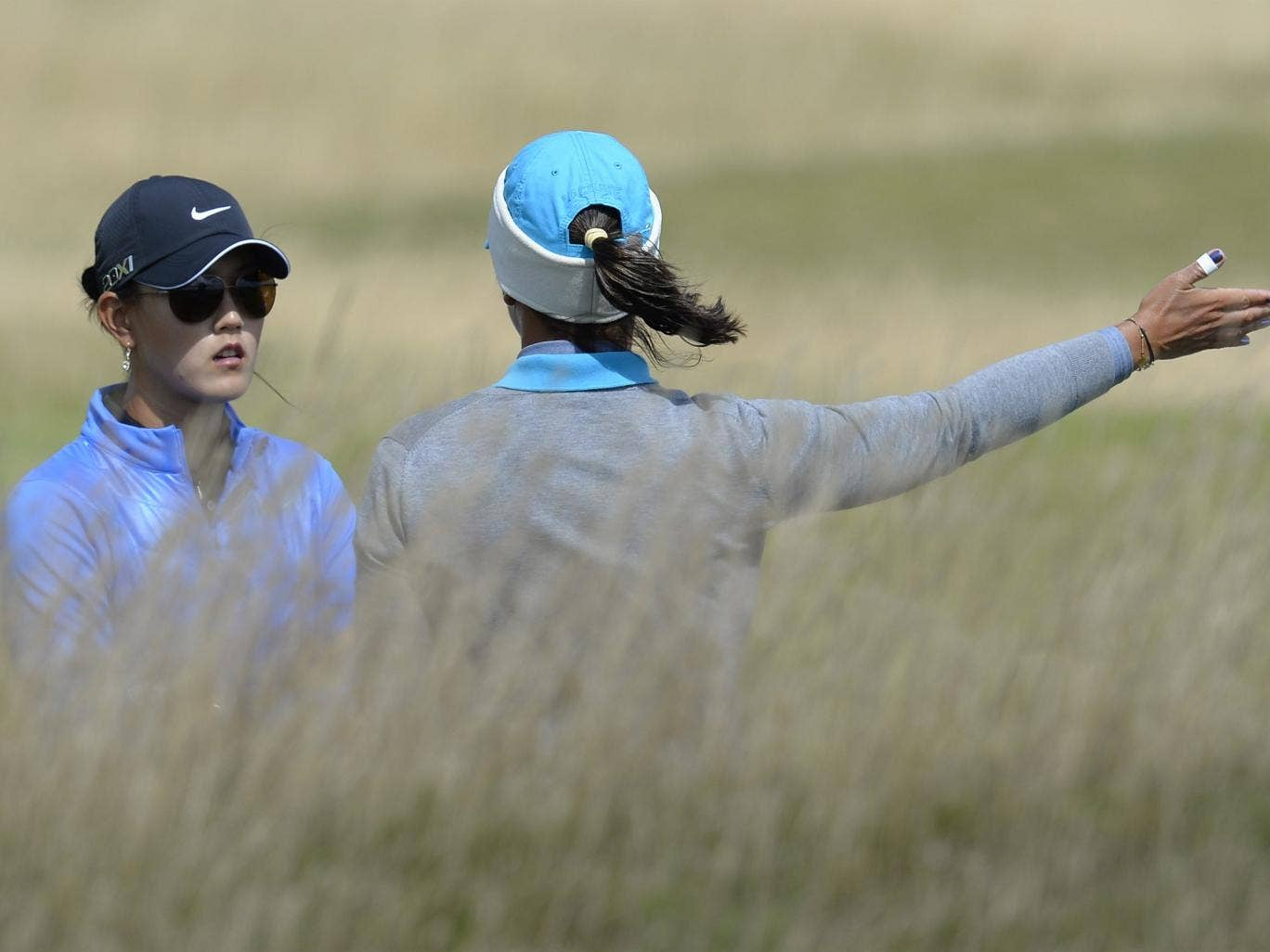 Michelle Wie, (left) and Karine Icher feel the force of the wind
