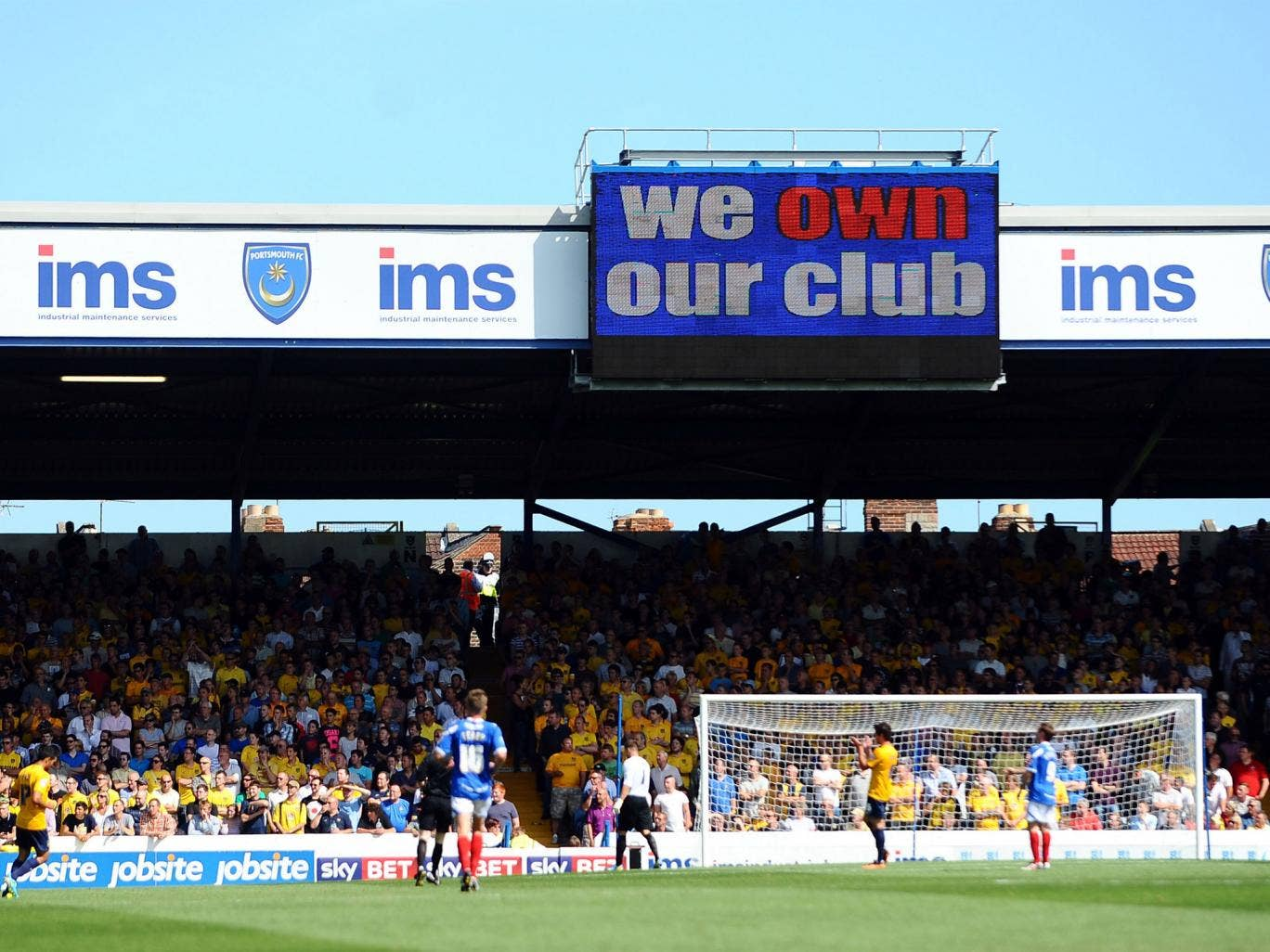 Fratton Park was full to capacity but Portsmouth supporters saw their fan-owned club crash to a heavy defeat