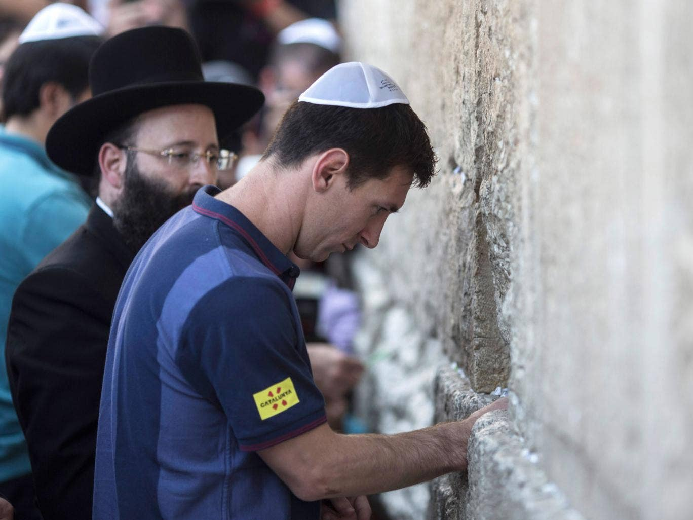 Barcelona footballer Lionel Messi places a wish on Jerusalem's Western Wall