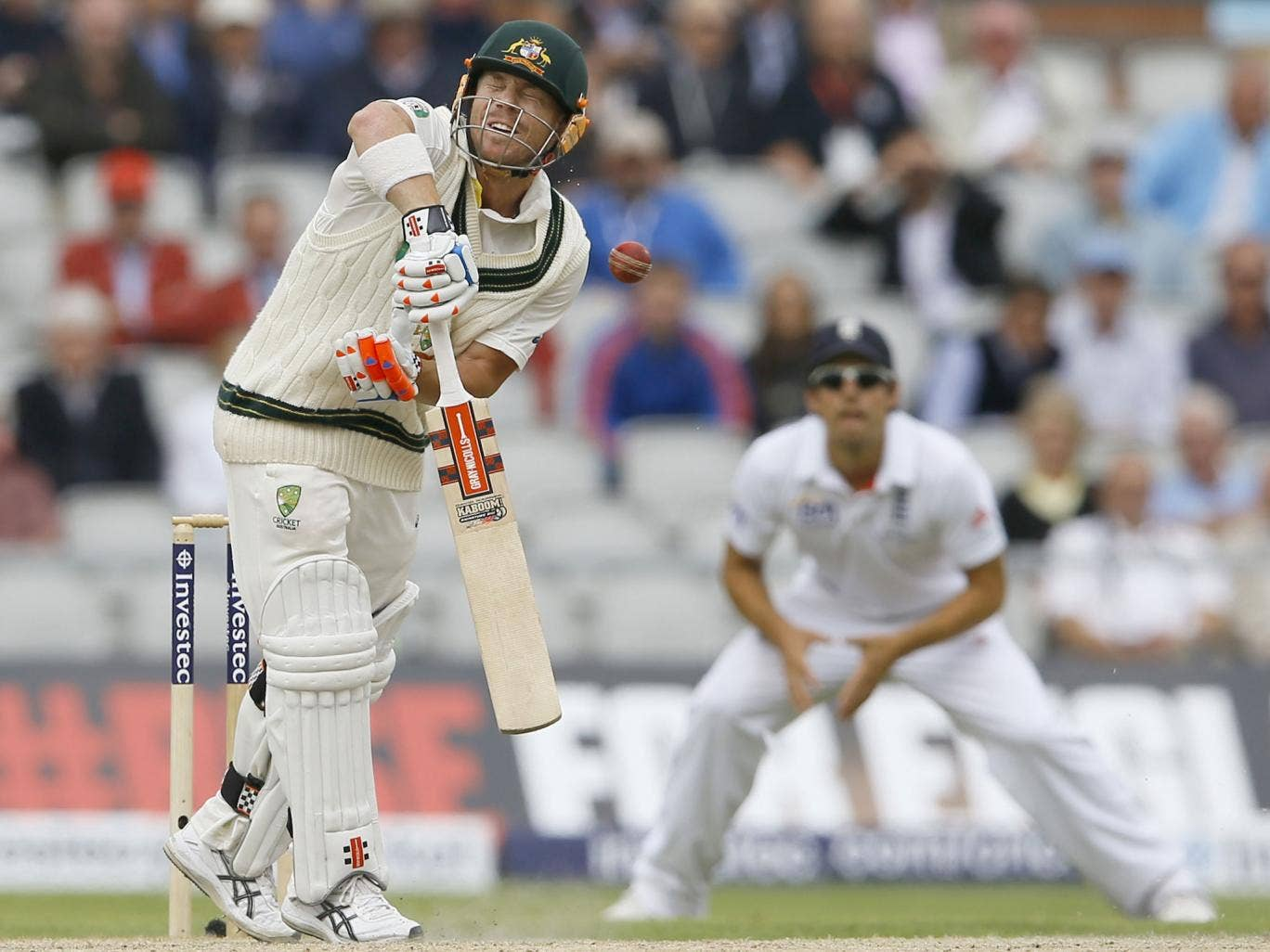 David Warner takes a hit from a Stuart Broad delivery