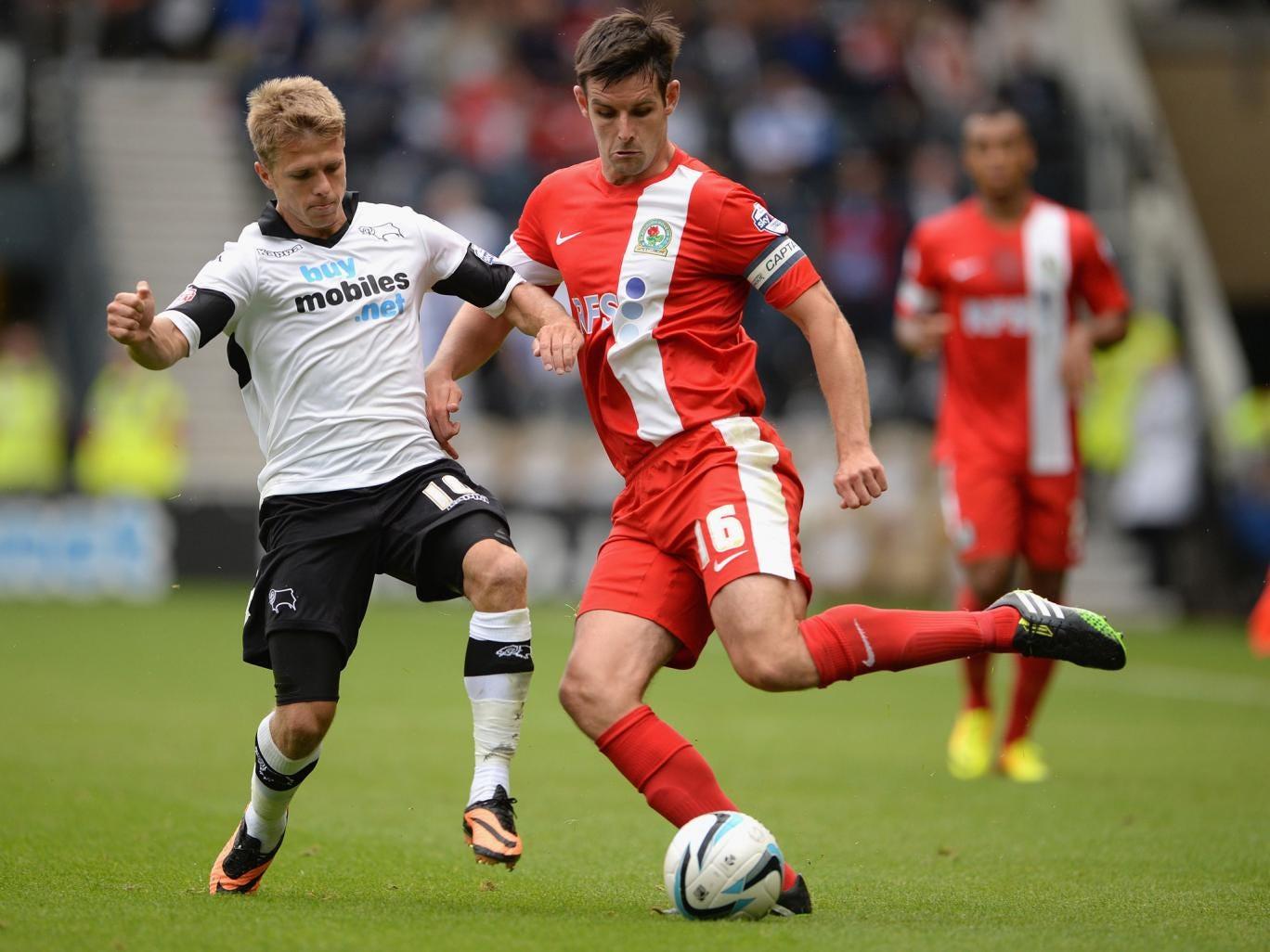 Derby's Jamie Ward, left, challenges Scott Dann, right, of Blackburn