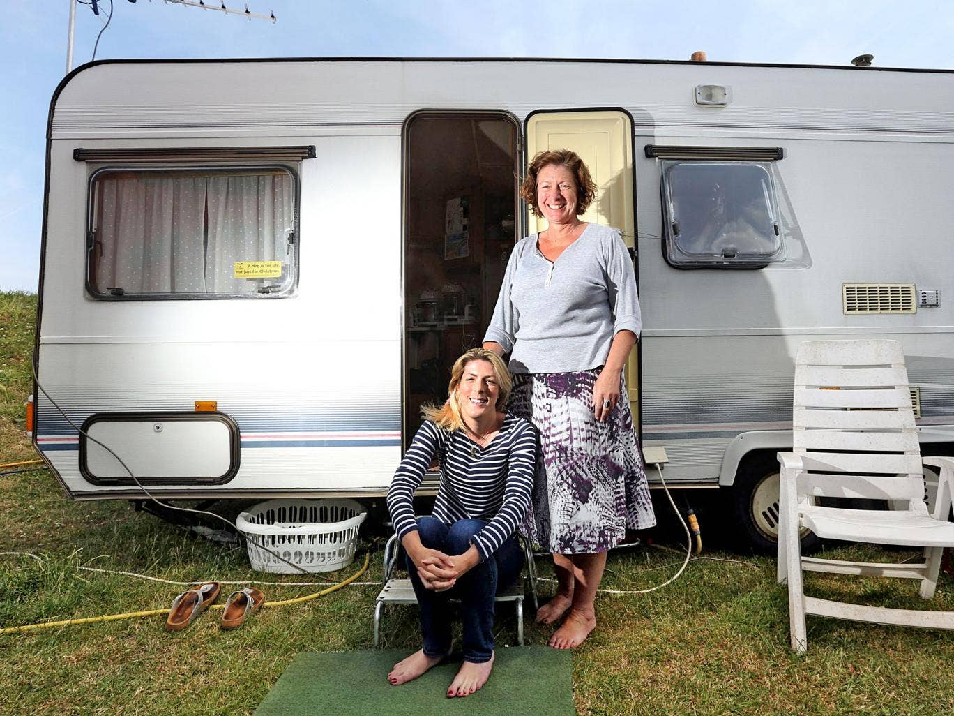 Fairground attraction: Zoah Hedges-Stocks, 23, with her mother Bernice outside their caravan