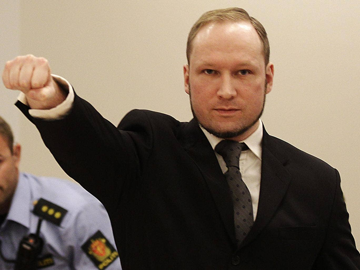 Anders Behring Breivik gives a Nazi salute in a Norwegian courtroom