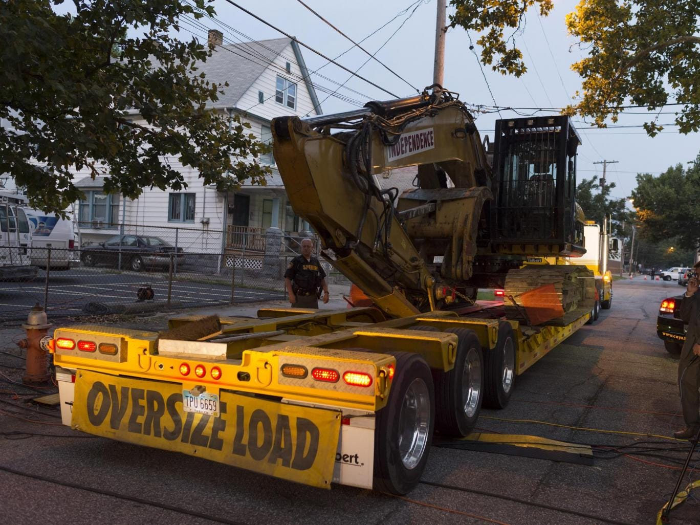 Demolition crews arrive at the home of Ariel Castro in Cleveland, Ohio. Castro was found guilty of abducting three young woman between 2002 and 2004 and today The State of Ohio will tear down his home