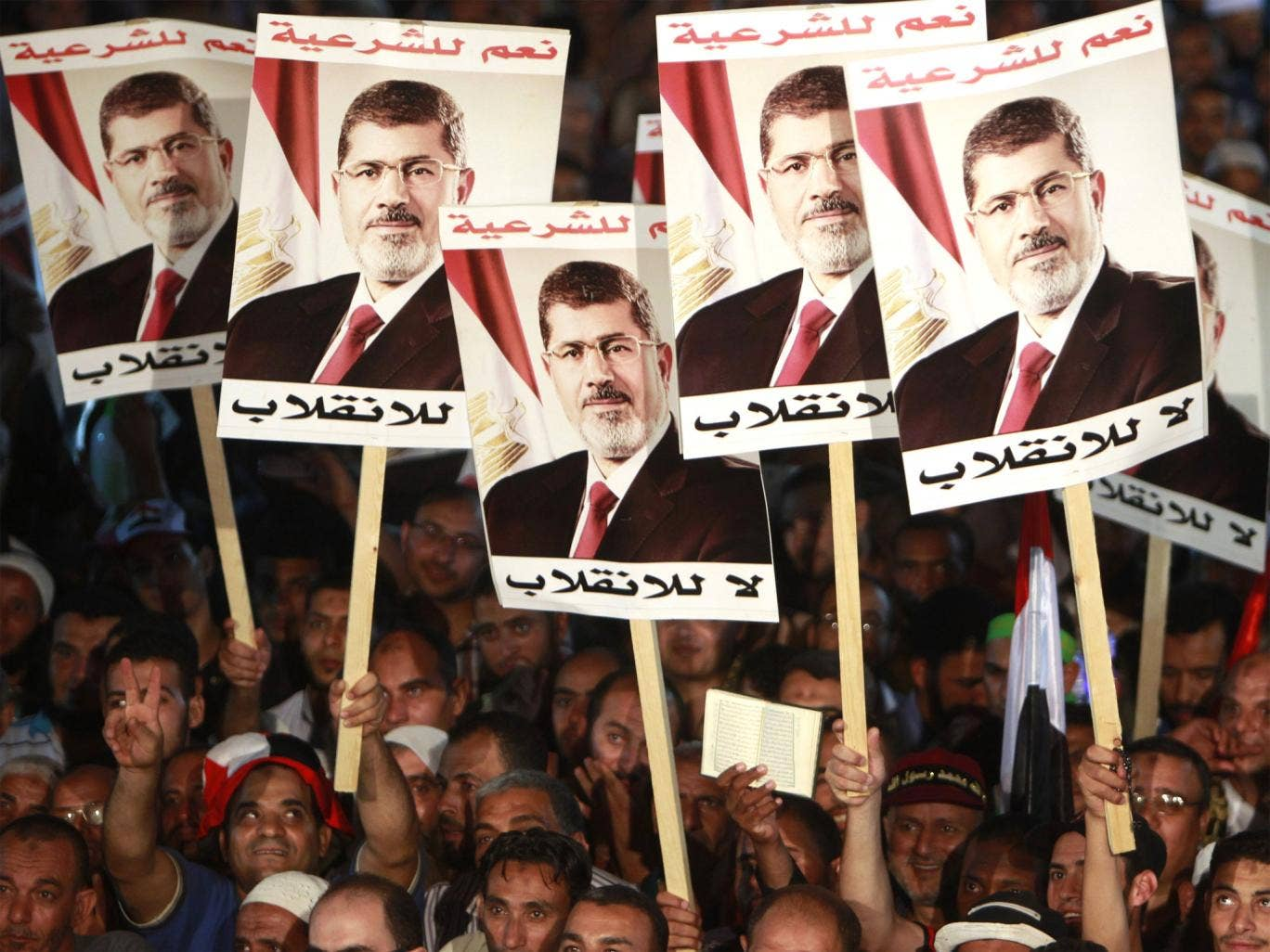 Supporters of deposed President Mohamed Morsi protest at Rabaa al-Adawiya square in Cairo