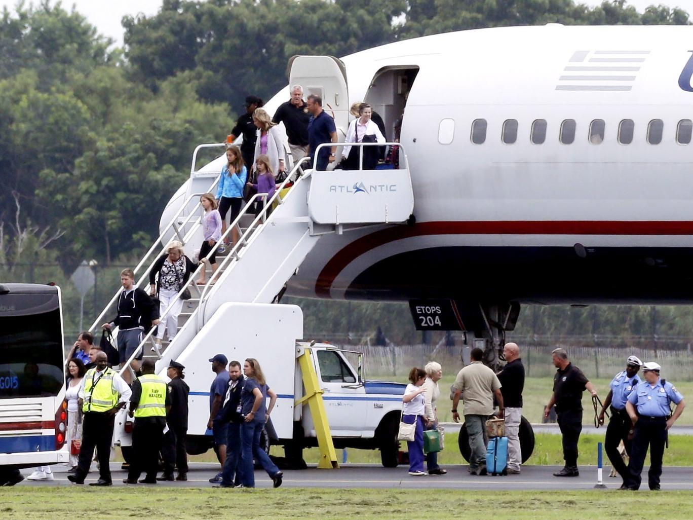 Passengers exit the plane in Philadelphia