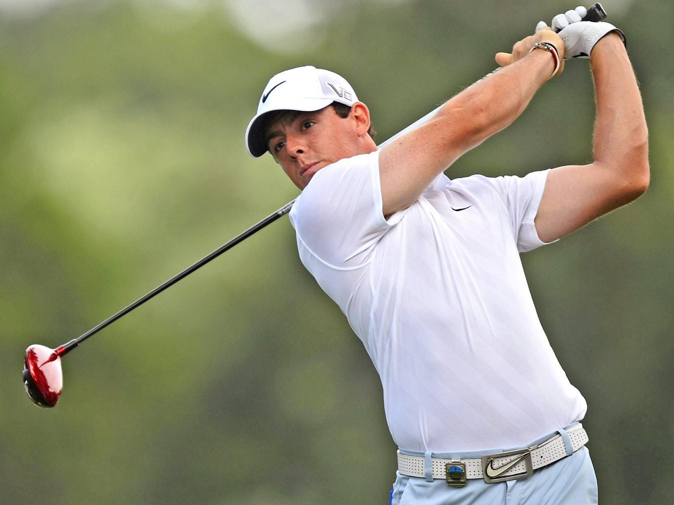 Rory McIlroy hits a tee shot at Oak Hill during practice